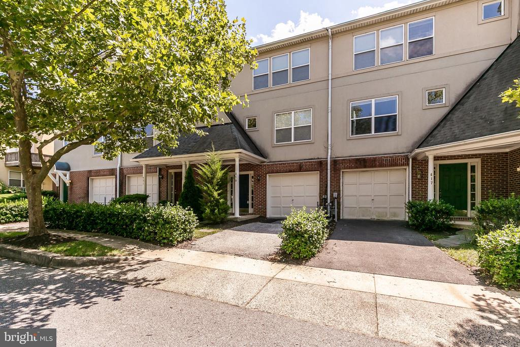 Large Town home with vaulted ceilings, open floor plan; lots of closets; powder room on both LL and 1st floor + 2 full baths on sleeping level! Deck off kitchen overlooking private open space! Gated Community in heart of Homeland - lots of amenities - Community Club House; beautiful pool; convenient to town, Towson and Roland Park!