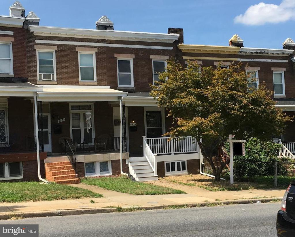 Best of Hampden! Fully renovated 3 bed 3 bath house. Open layout. Master bedroom suite w/ jacuzzi bath tub. Brand new designer kitchen w/ granite & SS appliances, new bathrooms w/ custom tile, laundry conveniently located on bedroom level, original wood floors, new electricity, plumbing and central air. New windows,  doors, recessed lighting and modern fixtures throughout. Fresh new deck overlooking backyard. Garage in the rear w/ 2 parking spaces. Lots of space. Modern living hon!