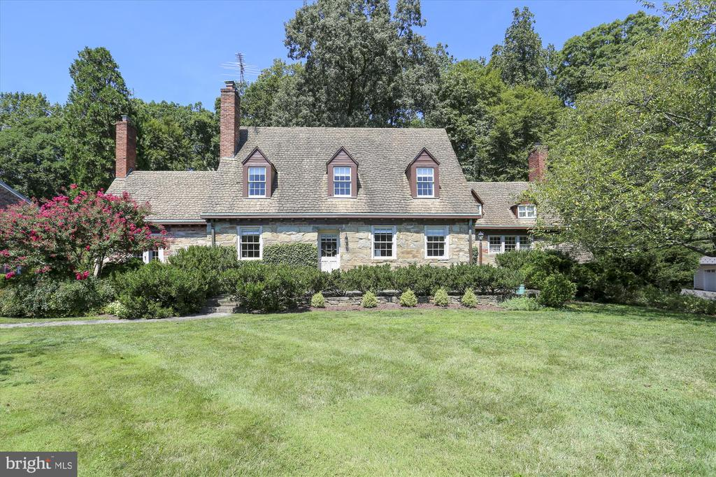 """Backing to parkland, this stone home was the manor home originally built for Charles Merryman, who was a landscape contractor and later became the superintendent of grounds for the Washington Cathedral. Designed and built to impressive standards for its time, this home's elegant and comfortable English farmhouse aesthetic has stood the test of time.  This home has an interesting history that is detailed in the accompanying """"History of Weathered Oak Herb Farm House"""" written by a former owner. From the charming English boxwood hedged patio outside the kitchen, the big windows in the kitchen and dining room and the sunroom off the family room, this home emphasizes its surroundings. Four bedrooms (huge master has a large sitting room attached), 3 full baths and charm to spare.  One of the bedrooms is on the main level.   Wonderful neighborhood.  Large lots, quiet setting but also very close to schools.  Path that leads to Seven Locks ES is nearby."""