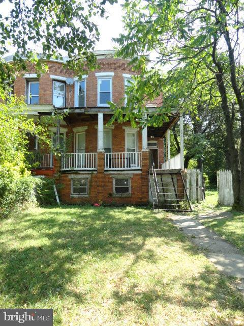 GREAT INVESTMENT OPPORTUNITY!!! THIS LARGE PORCH FRONT SEMI-DETACHED ROWHOME INCLUDES 5 BEDROOMS, 2 BATHS, 2 KITCHENS AND LARGE REAR YARD! CLOSE TO TRANSPORTATION, SHOPPING AND DRUID HILL PARK!! CURRENTLY TENANT OCCUPIED