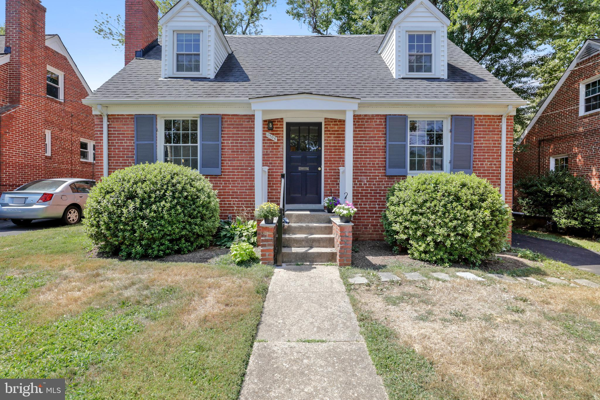 CHARMING ALL-BRICK CAPE COD IN SOUGHT-AFTER NORTH RIDGE AREA -- convenient to the Bradlee Shopping Center, plus the shops, eateries, movies, theater of Shirlington, and minutes from Old Town. Remodeled kitchen with granite counters and high-end appliances by GE and Fisher & Paykel, open to dining room. Both baths have also been stylishly remodeled. Hardwood floors are newly refinished, and the HVAC system, water heater, and roof are all recently replaced. The full, unfinished basement was professionally waterproofed in 2019 with a warranty that is transferable to the new buyer. The back yard was professionally landscaped, and includes a deck with hot tub and a lovely stone patio.