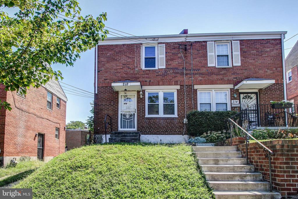 Price Reduced.  Seize the opportunity to update this semi-detached Federal with separate dining room, finished basement, 2 bedrooms and 1 full bathroom, light filled from 3 sides. Generous yard for romping, wood floors, central air conditioning, recessed lighting, Located approximately 10 min walk to Capitol Heights metro station. Sold as-it-is.
