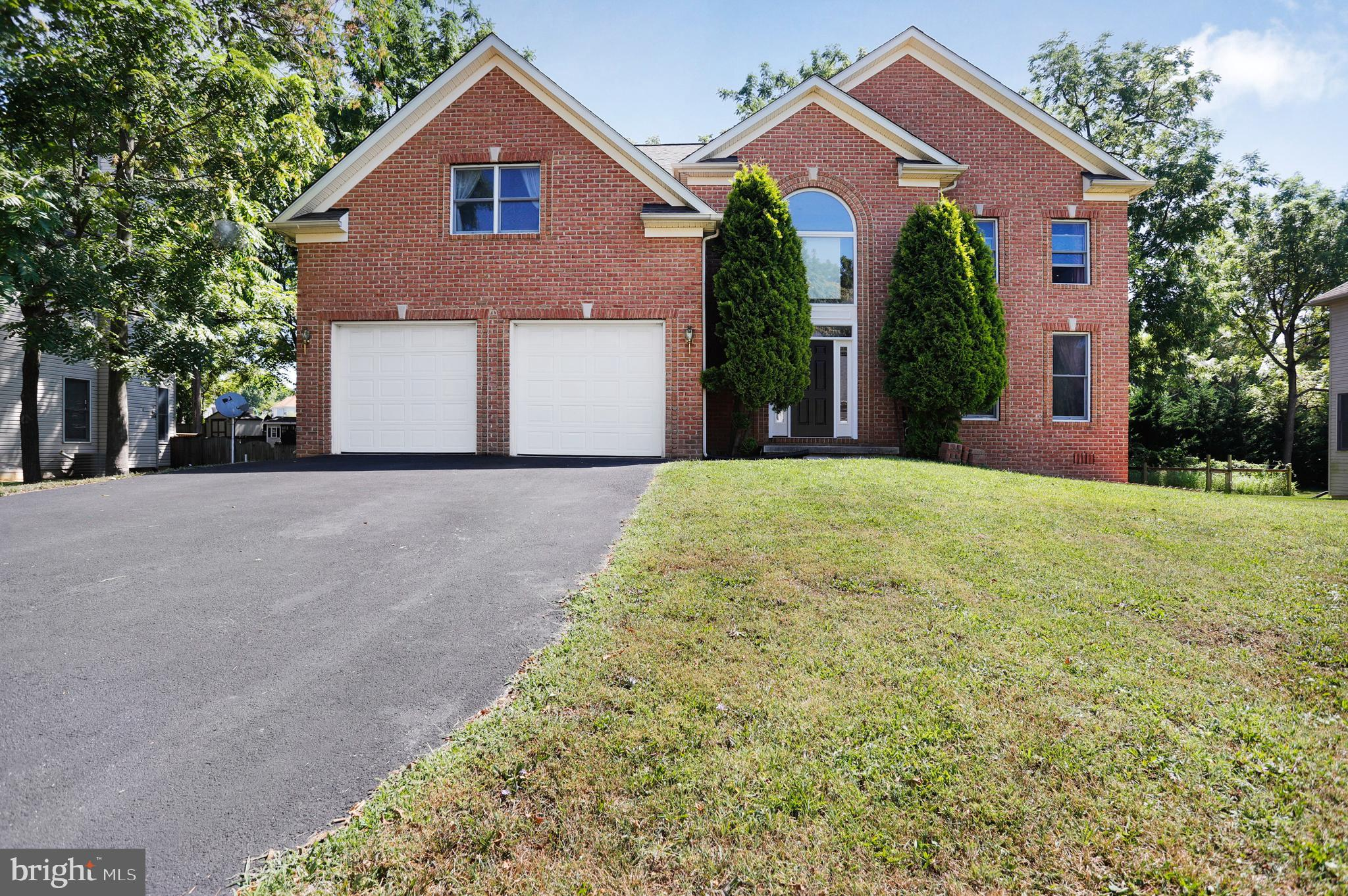 Welcome home! This  gorgeous brick colonial is located minutes from commuter highways, restaurants, and the community college. This home offers 4 large bedrooms, 2.5 baths, and an unfinished basement. Outside you'll find a two car garage, and a serene backyard. A deck is also located off the back the home for family and friend gatherings! Enjoy this lovely home with NO HOA.