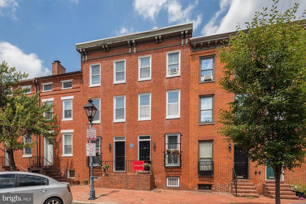 ONE OF A KIND Gorgeous TWO townhouses combined into one large  (740-742 Mchenry/ QUIET STREET) with private FENCED backyard backing to the PARK!! 3 blocks to to UMB & UMD medical & Camden yards!!Main level features a bright open floor plan, entry foyer w/ granite tiles, powder room, DEN, 2 story living room with CATHEDRAL ceilings & SKYLIGHTS, floor to ceiling MARBLE fireplace& two French doors leading to a lovely brick yard perfect for BBQ!! CHARMING Dining room w/ exposed brick wall open to a TERRIFIC modern kitchen with granite floors, white cabinets, Corian tops, black & stainless steel appliances & a breakfast BAR open to the dining room.  Second level features BRAND NEW FLOORS a DELIGHTFUL den w/ exposed brick wall, a SPACIOUS master suite with many closets & additional SITTING room w/ built in bookcase and a full bathroom. Third level features BRAND NEW FLOORS,   3 bedrooms, one full bath and a FULL SIZE  laundry closet. Spacious unfinished basement provides additional room for storage. Up to 4 permanent  PARKING Spots in the neighborhood and 2 for guests !! MINUTES TO DOWNTOWN. Property in very good condition: To be sold AS-IS. Owners agent. Very easy to show!! Call Rima at: 202 439 7878