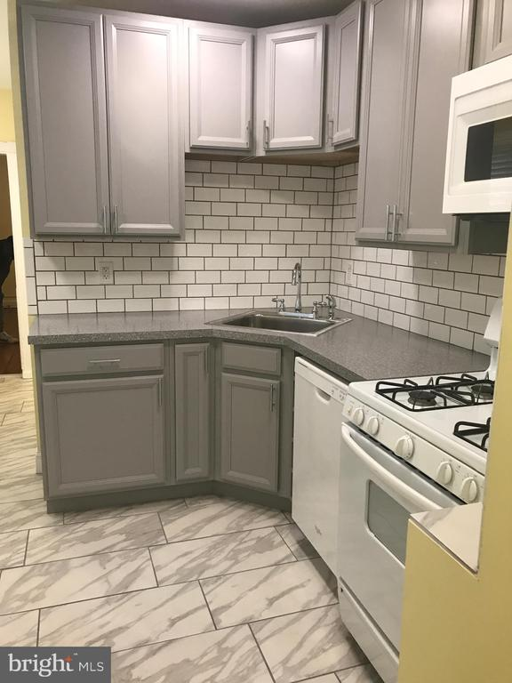 Spacious 2nd floor apartment located in the heart of Little Italy. Recently remodeled Kitchen & Bathroom & two very large bedrooms. Hardwood floors & ceramic Tile through the whole apartment.This is a must see.