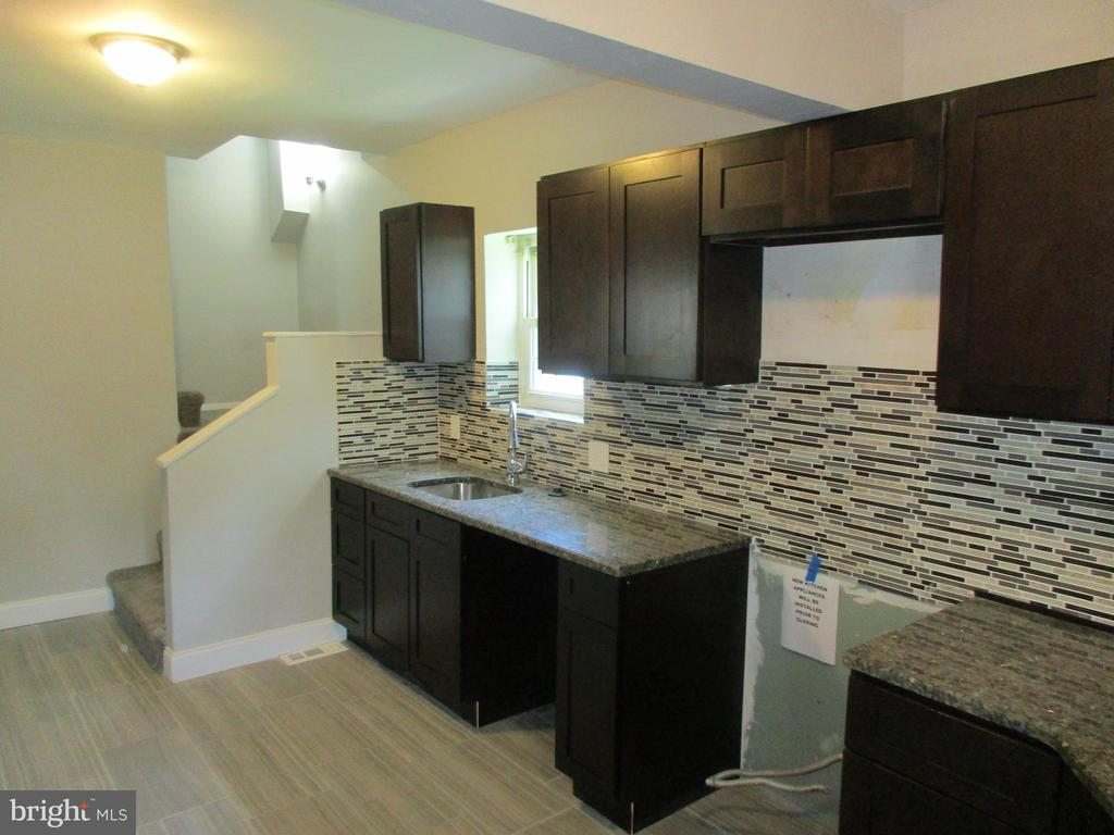 Move right in to this beautifully remodeled 3 bedroom 2 and half bathroom home.  Attached bathroom to master bedroom.  Kitchen has granite counter tops tile back splash and 2 separate sinks. Fully finished basement. Deck off kitchen.  Nice level fenced in yard, Quiet neighborhood.  New floors new kitchen new bathrooms.   Freshly painted.