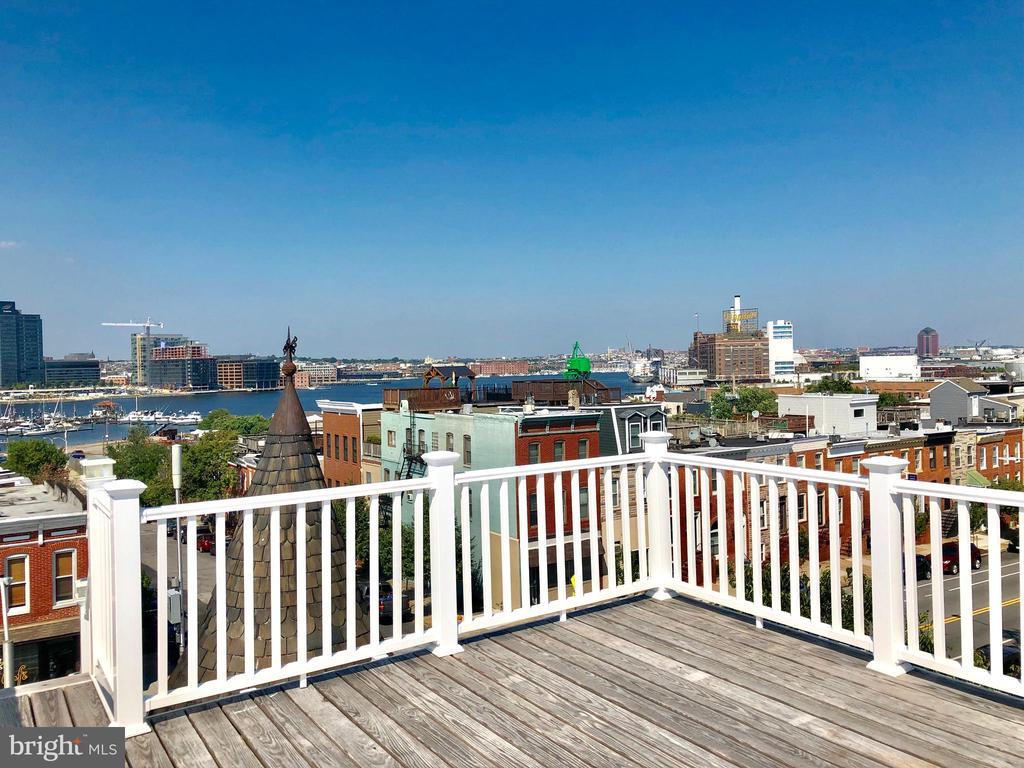 * REAL ESTATE AUCTION ON PREMISES & ONLINE FRIDAY OCTOBER 18TH @ 12:00 PM. BY ALEX COOPER AUCT* List price is suggested opening bid only pre-auction offers considered !!   ***STUNNING ***STUNNING HARBOUR VIEWS & REMODEL*** Enjoy This Downtown Baltimore Home that includes 2 rooftop decks, 360 degree views, gorgeous updates, 2 master bedrooms each with their own master baths, top floor suite with built-in bar and access to the most amazing cityscape.  The basement has been smartly finished with a full bath, media/entertainment room, and an additional finished room to use however you see fit.  The Kitchen is beautiful, truly state of the art, and it flows into the living area.  The Garage is over sized and unusually tall.  This is just an exceptional opportunity~ Come See For Yourself !!   -- Buyer~s Premium 6% -- Coop is 2% -- $600,000 Suggested Opening Bid -- Subject to seller confirmation -- Broker coop form is attached