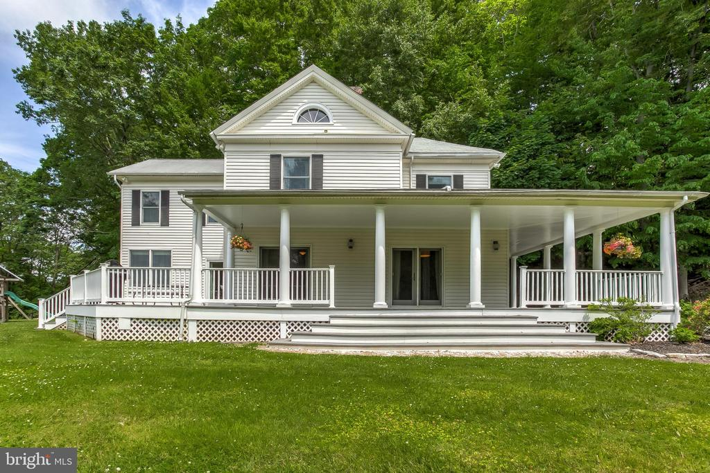 PRICED REDUCED! Picturesque 4 Bedroom, 2.5 Bath home situated on 2.64 acres in the heart of Greenspring Valley is conveniently close to restaurants and shopping. With the soul of the original 1909 farmhouse intact, and many original architectural details throughout, a clever 3-story addition increases the home~s total square footage with expanded and updated living spaces, including a light-filled living room off the kitchen, a large owners~ suite with enviable bath and walk-in closet, and lower level game room. Blending rustic and modern elements, the kitchen exudes charm, while the expansive wrap around porch and deck invites you to dine and unwind outdoors while taking in the sweeping views of your private retreat. Prepare to fall in love!