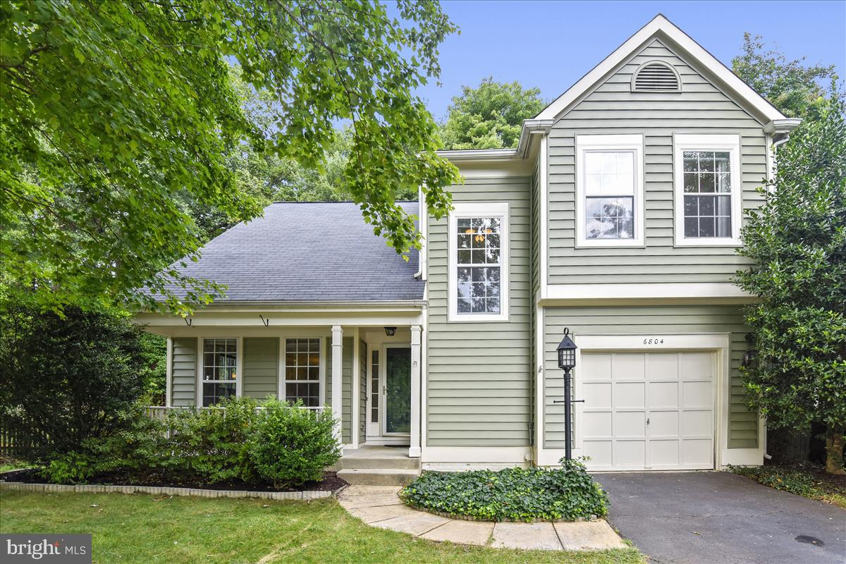Lovely home in Woodstone on a tree lined culdesac! Large fenced in 1/3 ac lot backs to wooded area. Updates include Stainless steel appliances, granite counter tops, hardwood flooring and new carpet.Sq footage including the finished lower level approx 2400. Enjoy nearby Lee District Recreation Center! Some photos are virtually staged.