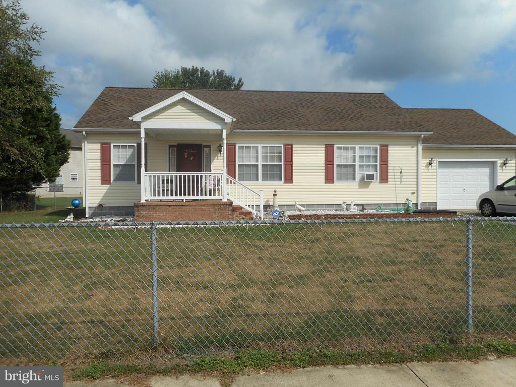 This spacious 3 bedroom 2 bath rancher features an attached garage, front porch and fully fenced yard.