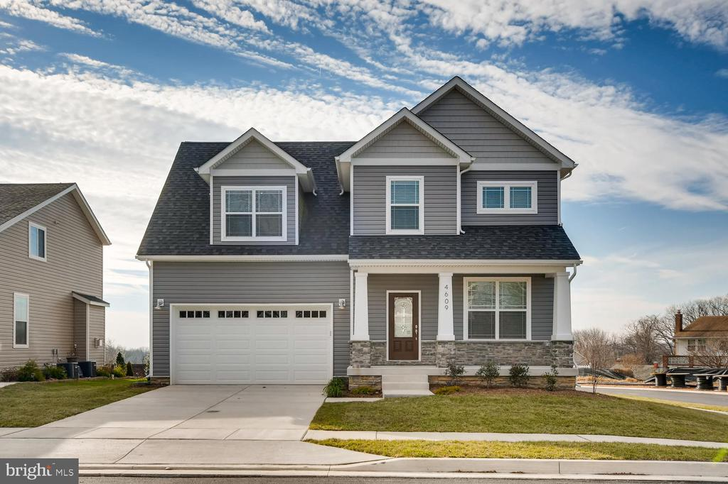 New Home to be completed by early September: Custom Gourmet Kitchen w/farm sink. Hardwood floors on the main level. Stainless Steel Appliances. Finished Lower Level with Bar, Electric Fireplace and Fifth Bedroom with a Full Bath. Spa style Master Bathroom. LED Lighting Package. Optional Deck.