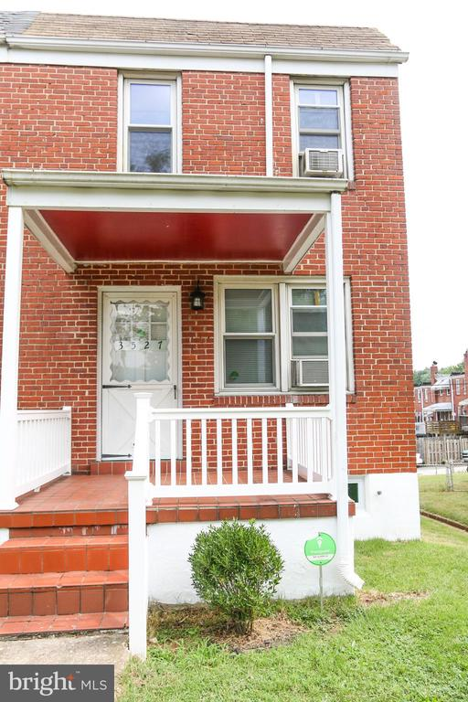 Lovely end of group townhome.  Move in ready with 3br and 1 BA.  Freshly painted with Hardwood floors throughout.  Updated kitchen that opens to dining room.  Front and back porches.  Parking for 2 cars in rear.  Newer windows, water heater installed in 2006, Gas furnace new in 2009, Roof re-coated in 2019.   All 4 window a/c units convey with sale.    The square footage livable area may be slightly higher than stated, closer to 1,100 sq ft.    Close to Rt.95, 695, minutes to downtown.  1 Block from St. Agnes Hospital.  Don't miss this great home!