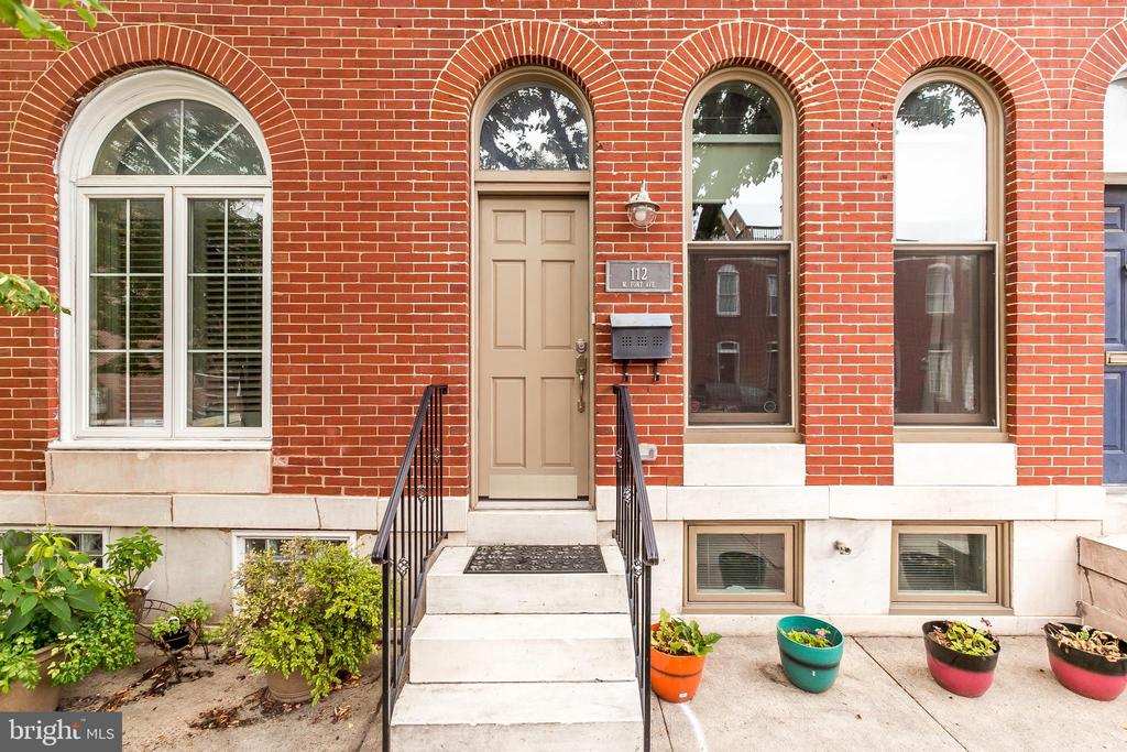 Completely renovated Federal Hill Townhome.  This home has over 6 years remaining on the CHAP tax credit.  Beautifully appointed with attention to detail and historical elements.  Home boasts, original tin ceiling in kitchen, coffered ceiling in living room, wood floors throughout.  Granite countertops and stainless steel appliances.  Pot filler, full size washer and dryer and a laundry chute for added convenience.  Enjoy the fully finished lower level with its own bath.  Take in the city skyline views from the rooftop deck and enjoy the ease of off street parking.