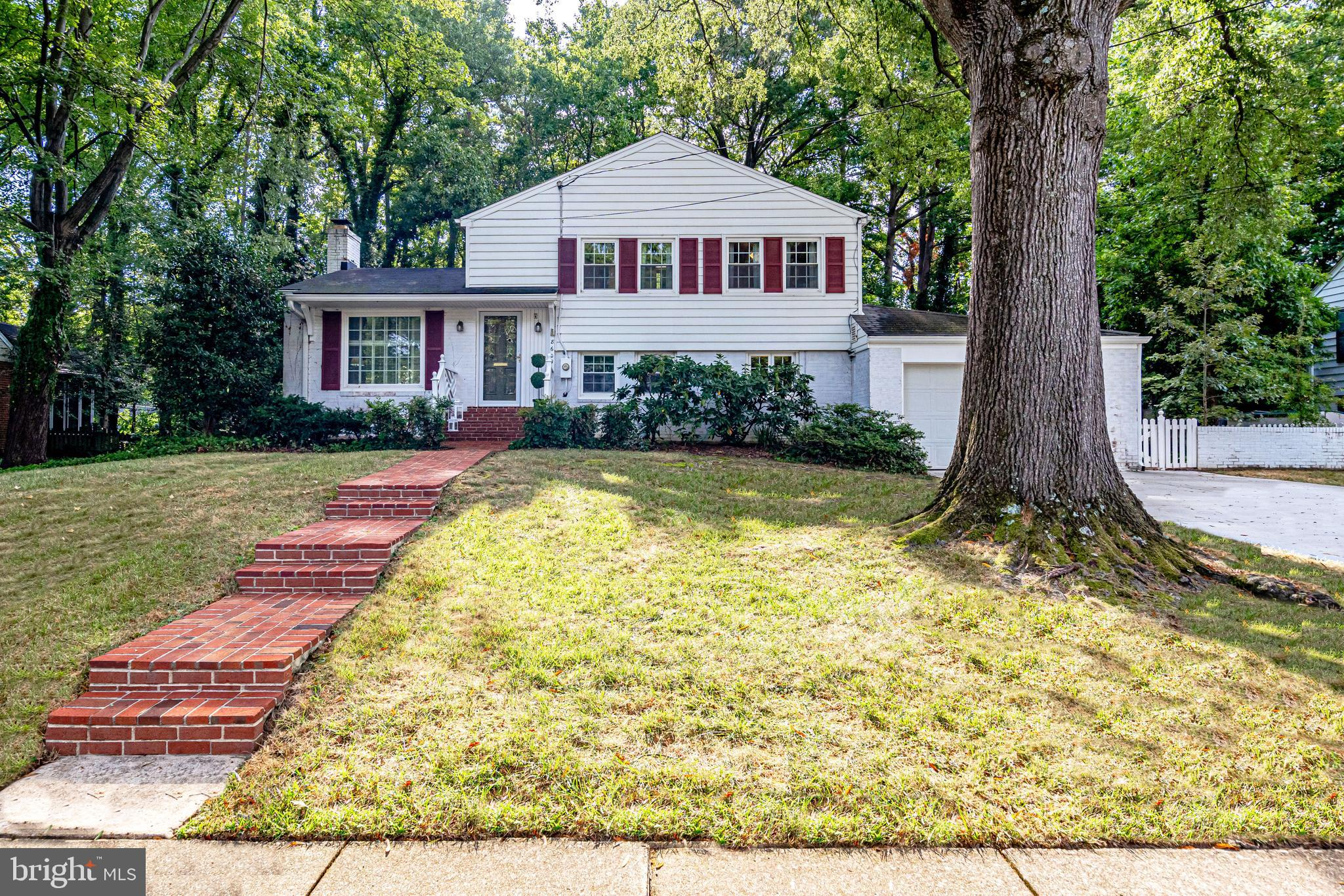 Expanded and backing to the community pool- this 4 level Salem Model offers many updates and features including an oversized 1 car garage, 3 season sunroom or all year mudroom, large vaulted ceiling family room addition with fireplace (16 x 20), brick patio, fenced in backyard, double pane vinyl windows, remodeled full bath. Covered patio off living room. 3 bedrooms + Den! HVAC 2010, Hot Water Heater 2015.  Brand new concrete driveway.  Current owners have loved and maintained this home for 30+ years however the home is ready for some cosmetic updates.  The home is in great condition and shows well!