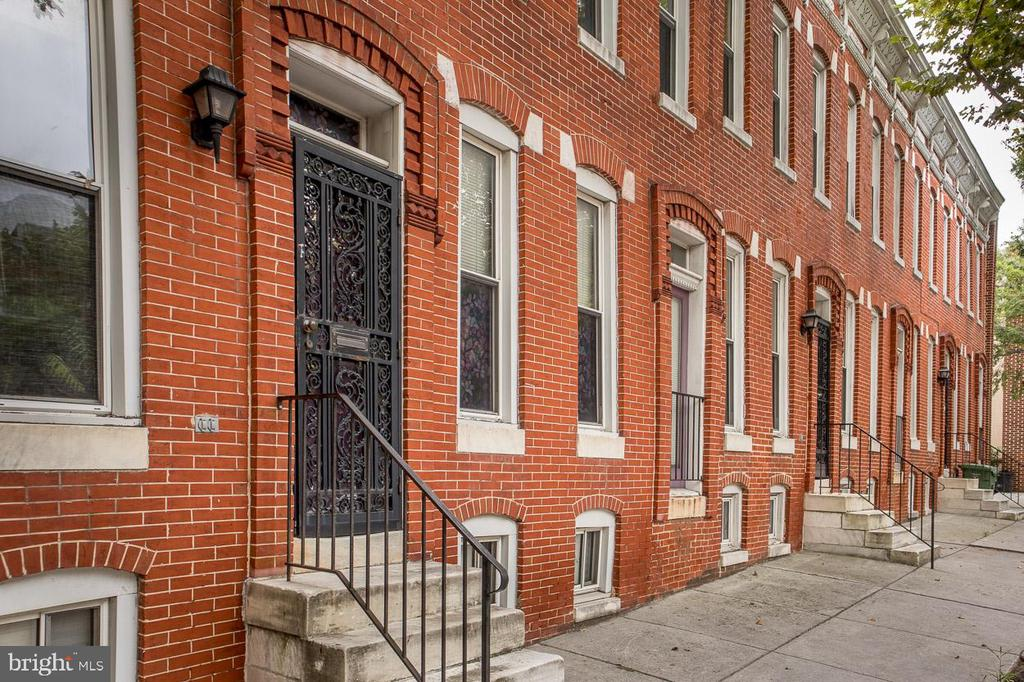 Brick Rowhome in the heart of Sandtown-Wincheser Square.  This is one of the largest homes in the community with a double lot!  Features 4 BR, 2.5 BA, updated Kitchen with SS Appliances, Master Suite w/Bathroom and Walk-in Closet. New Roof (2018). Some New Windows. Carpet and Laminate Flooring. Sprinkler System. Basement is Unfinished with plenty of room for storage. Cover rear Patio.  Common Parking Lot for easy parking.
