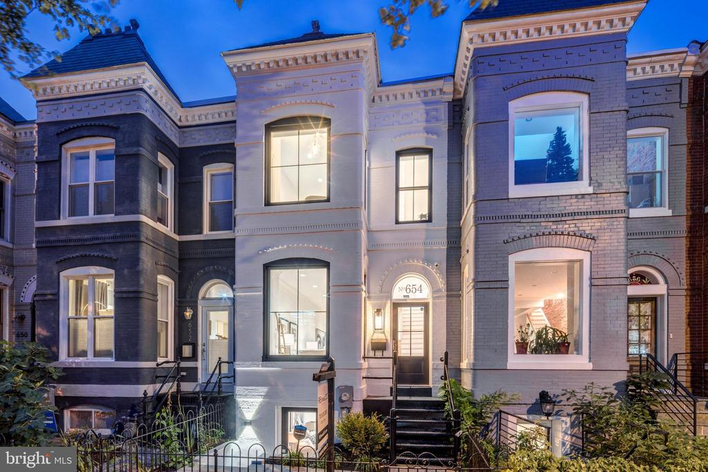 Refined, Cultivated, Cultured, and Sophisticated are just a few words that can begin to define this Capitol Hill fully-renovated Victorian home! Located just south of H St Corridor, over 2,500 sq. ft. of sheer elegance on a 1,625 sq ft lot is the perfect canvas for a modern luxury DC lifestyle. An inviting bright open-concept floor plan with an abundance of natural light flooding through oversized windows and doors. Stunning French oak floors carried throughout this custom home with high ceilings that create an atmosphere of spaciousness. Unique contemporary black & brushed-gold hardware, shiplap paneled walls and designer fixtures flow throughout the home. This one-of-a-kind home provides 4 spacious bedrooms, 3.5 exquisitely designed bathrooms, with full guest accommodations on the lower-level. The first floor boasts a stunning custom chef's kitchen, high-end appliances, six range stove top, and quartz countertops. Backside of property has a direct entry garage with a spacious deck. Property features include a fully-wired surveillance system and sound system. Located within walking distance to Whole Foods, H St corridor, shops, restaurant, Union Market and Union Station.~