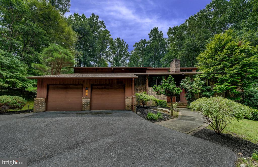 CONTACT ALT AGENT WITH ALL QUESTIONS! MOTIVATED SELLER!! DON'T MISS THIS FANTASTIC OPPORTUNITY! OVER 6100+ SQUARE FEET IN A GATED COMMUNITY 0N 4.5 ACRES RIGHT ON THE LOCH RAVEN RESERVOIR! 6 BEDROOMS 5 FULL BATHS, NEWER KITCHEN AND APPLIANCES WITH ISLAND AND EAT IN AREA,BEAUTIFUL STONE STACKED FIREPLACE IN LIVING ROOM LARGE FAMILY ROOM OFF KITCHEN WITH FIREPLACE #2, SEP DINING ROOM WITH BUILT IN BAR, NEWER MASTER BATH, LARGE MASTER WALK IN, GENEROUS ROOM SIZES, BASEMENT HAS ADDITIONAL ROOMS/OFFICE OR BEDROOM SPACE AND IS FULLY FINISHED WITH LARGE LIVING AREA, MULTI-TIERED DECKS AND BALCONIES INCLUDE A BALCONY OFF THE MASTER BEDROOM! LIGHT FILLED SUNROOM, SO MUCH PRIVACY OUTSIDE WITH HIKING AND BIKING TRAILS ALONG THE WATER IN ONE OF THE AREA'S PREMIER COMMUNITIES! LOTS OF USEABLE BACKYARD FEELS LIKE A VACATION! MOTIVATED SELLER! TAKE ADVANTAGE OF THE UNDER MARKET PRICE!!