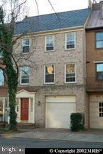 """Picture yourself in this brick Town-home, only 3 doors up from the Potomac River, exit your front door that provides breathtaking view of Founders Park which is on the Potomac River in Old Town Alexandria, close to restaurants, shopping and the Torpedo Factory - 3 Bed Rooms, 2 1/2 Baths, with one car attached garage, Fireplace with extra high ceiling, French doors to your fenced in rear yard, basement includes washer and dryer, and attic space for extra storage.  PRICED to reflect the location and that the property has not been substantially updated, recently painted, and the property is """"move-in"""" ready - no smokers please, pets on a case-by-case basis, credit report/score with first month's rent and deposit to be submitted with rental application, contact agent for active military pricing, $250 minimum repair deductible..."""