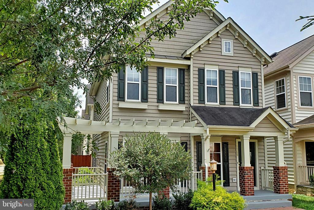 OPEN HOUSE Sunday, 8/25, 1-3pm. Thoroughly upgraded Colonial in PRIME location just 1/2 mile to VRE train station and 1 mile to Amtrak station.  New carpet and fresh paint throughout.   Other recent upgrades include HVAC (2016) and bathrooms.  Spacious open floor plan - perfect for comfortable family living or gracious entertaining.  Hardwood floors on main level. Newer stainless steel kitchen appliances. Oversized windows provide abundant natural light throughout. 2 master suites, one with luxury bath, jacuzzi tub. 2 car attached garage.  Lower level media room with wine bar - wired for entertainment system.  Lots of storage space in basement.  Wraparound front porch overlooks common lawn area, and fenced in side patio.  Excellent HOA amenities, including swimming pool, clubhouse, tennis court, playground.  Stones throw from Lorton Town Center shops & restaurants and Vamoose bus to NYC.