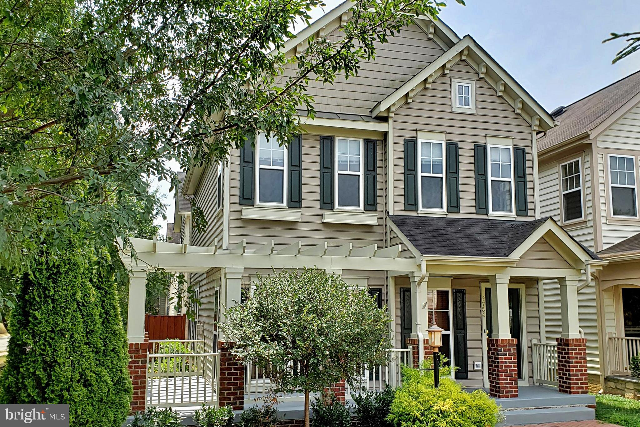 OPEN HOUSE Sunday 9/22, 1-3pm. Thoroughly upgraded Colonial in PRIME location just 1/2 mile to VRE train station and 1 mile to Amtrak station.  New carpet and fresh paint throughout.   Other recent upgrades include HVAC (2016) and bathrooms.  Spacious open floor plan - perfect for comfortable family living or gracious entertaining.  Hardwood floors on main level. Newer stainless steel kitchen appliances. Oversized windows provide abundant natural light throughout. 2 master suites, one with luxury bath, jacuzzi tub. 2 car attached garage.  Lower level media room with wine bar - wired for entertainment system.  Lots of storage space in basement.  Wraparound front porch overlooks common lawn area, and fenced in side patio.  Excellent HOA amenities, including swimming pool, clubhouse, tennis court, playground.  Stones throw from Lorton Town Center shops & restaurants and Vamoose bus to NYC.