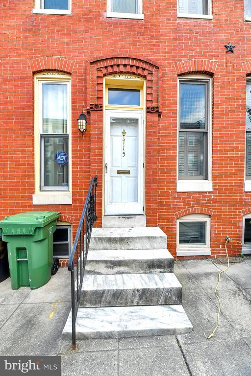 Spacious and Well-Maintained Row Home in Desirable Ridgley's Delight! High Ceilings, Upstairs Laundry, and Trex Deck off Rear!  Backs to Green Grass! Huge Unfinished Basement for Added Storage.  Fresh Paint Makes it Shine. Quiet Street with Plenty of Parking! Easy to Show and priced to Sell!