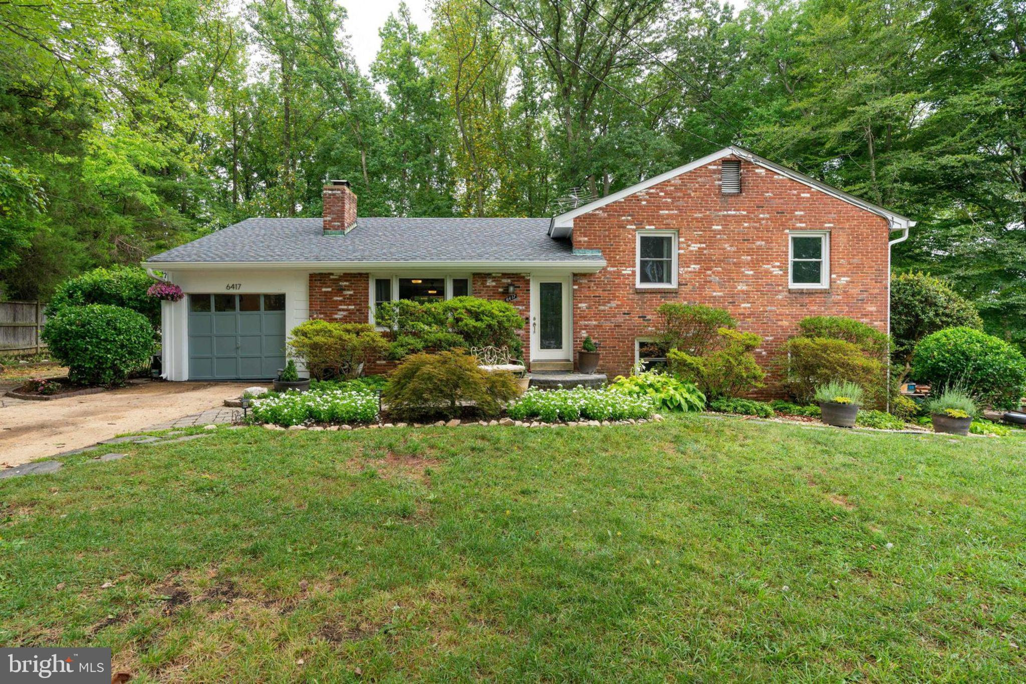 Lovely 4 bedroom, 3 bath split level backing to trees on almost an acre! Lots of updates await you! Updated kitchen with new stainless appliances and plenty of counter and cabinet space! Gleaming hardwoods throughout the main level! Updated master bedroom and master bath, as well as updated flooring. Additional three bedrooms with refinished, gleaming hardwood floors. Updated hall bath! Spacious lower level walk-out with lots of finished living space to be creative. Large rear patio is wonderful for outdoor entertaining! This home has only had two owners! Close to shopping, transportation and the 495/395/95 corridor! Hurry, this one won't last! Can do close to a 30 day closing if necessary.
