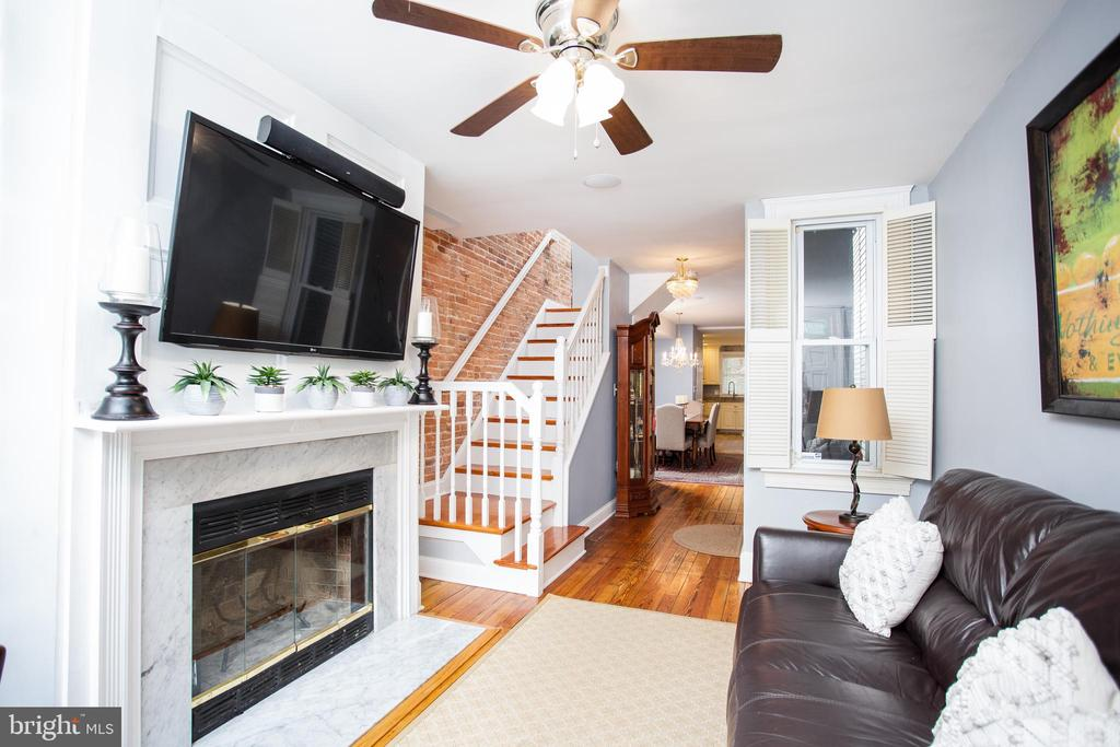 Big, Bright and Beautiful in the iconic Riverside neighborhood. An elegantly restored traditional Baltimore rowhome that boasts its original hardwood flooring and crown molding. Vintage shutters and other historic details complement the modern touches throughout. All four bedrooms above the main floor and large enough to fit king sized beds with room to spare. All of the bells and whistles that you would want in a renovated Baltimore home. Granite counter tops, exposed brick, trendy backsplash and tile work, glistening hardwood floors, multiple patios, roof deck, and parking!! Superior location that gives you the feeling of an oasis within the city. Moments away from Riverside park and a secluded private park behind it as well. A short walking distance to Pure Raw Juice (Baltimore's best juice bar) and other local businesses. A convenient distance to Cross St Market, the Inner Harbor and everything that Federal Hill has to offer. The rooftop deck allows you to have a breathtaking view of the Inner Harbor and front row seats to firework shows throughout the year. Widened and custom staircases in the home that make navigating the home a breeze and moving in even easier!