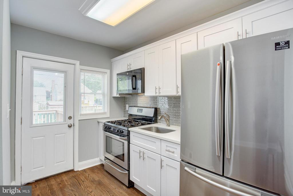 Newly renovated townhouse! 3 bedrooms, 2 full bathrooms. Hardwood floors throughout the main and upper levels. Brand new kitchen with granite countertops and stainless steel appliances. Fully finished basement.