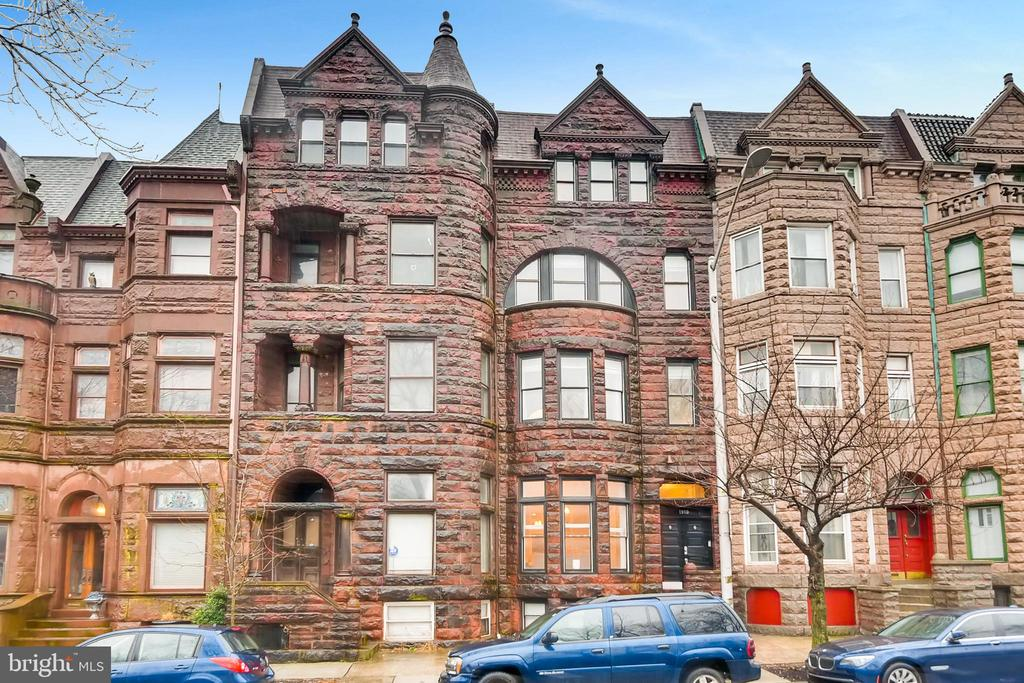 This gorgeous brownstone located in historic Bolton Hill is brimming with quintessential charm! Completely renovated & still full of historical integrity, this grand home offers nearly 7,000 square feet of updated living space, including 5 bedrooms & 5.5 bathrooms. Explore multiple master suites, an enormous chef's kitchen, finished basement & multiple living spaces complete with a wet bar. Enjoy cool summer nights on the large rooftop deck & spacious patio. And, don't miss the 2-car garage! This home is a turnkey masterpiece & a truly rare find. There's nothing to do but move in!
