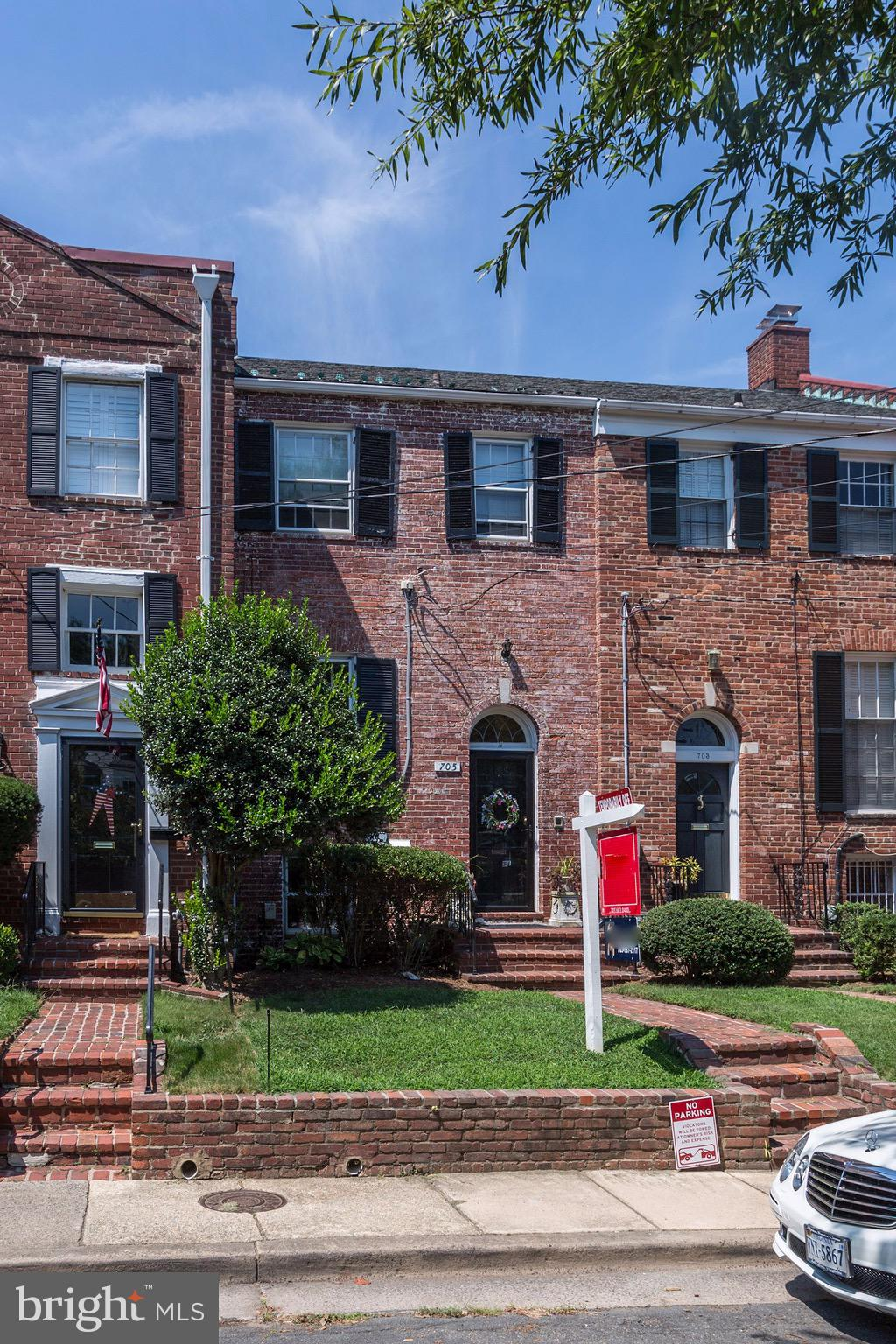 BACK ON THE MARKET! $55K PRICE REDUCTION! Completely renovated, 3-level, brick townhome located in the Yates Gardens neighborhood of the SE Quadrant of Historic Old Town Alexandria! Walls were removed & reconfigured to create new, open floor plans on the 1st & 3rd levels of the home. The 1st Floor comprises heated floors throughout, an open kitchen with a spacious island with granite countertops, a copper forged bar sink, additional storage & seating for four.   The space is complemented by a separate dining area which leads to the outdoor, private oasis - a large brick patio & tiered garden of mature plantings & trees.The living room is light-filled & open with floor-to-ceiling windows, a wood-burning fireplace, & a reading cove bookended with built-ins. The 3rd Floor comprises a master bedroom with en-suite bath & a double-sided, walk-in closet. The owner added a 2nd full bath to complement the guest bedroom. The attic space has been transformed into an accessible space with pull-down steps & sub-flooring to provide off-season storage. There is one assigned off-street parking space located at the foot of the front door. No HOA!  This home has it all!