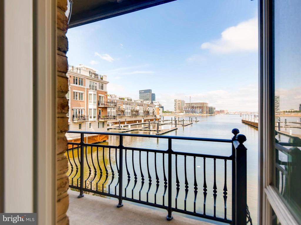 SHORT TERM RENTAL OPPORTUNITY! 6-18 month rental available October 1, 2019. Perfect for short terms needs. Take this rare opportunity to enjoy the exclusive Harborview community. This stunning waterfront townhouse will woo you with waterfront views from almost every room. In true luxury this Mediterranean-style townhouse allows you to have all the benefits of downtown living with the ease, convenience, and privacy of a single family home. Direct full horizon water views from all levels beg you to enjoy a moment or an hour gazing from a deck chair on one of the many balconies or the expansive roof deck. Enjoy living at its finest from this multi level town home with over 3000 square feet of finished elegance inside~then enjoy your massive roof top terrace from breathtaking views of the harbor by day and the city skyline by night.     Top of the line amenities including an elevator serving all levels (never lug groceries up the stairs again!) and Brazilian cherry wide plank hardwood floors on all three levels. The ground level provides a separated entrance to the home in addition to the garage entry and a private and secluded bedroom with a private deck and bathroom. One level above you will find a gourmet kitchen outfitted with granite counter tops, a generous breakfast bar and eat-at island. An open floor plan allows sunlight to fill the room no matter the time of day and the view to be appreciated no matter where you are. Up another level you will find the master suite with full height windows running the length of the townhome, to truly bring the view to your feet. Ample closet space and a luxury bathroom including separate soaking tub, oversized separate shower and dual wash basins with linen closet give you plenty of space to spreaf out and relax. A second bedroom is on the same floor, along with the laundry room for perfect convenience. Just one more flight up provides you access to the roof terrace which is sized to provide for dining, entertaining, sunbathing, and so much more; all at once if you wish! This is a home you must simply see to believe, and you will love every minute of your tenancy it will make you Buy this beautiful home. JOIN US WED. 10/2 FOR OPEN HOUSE FROM 4-7PM.