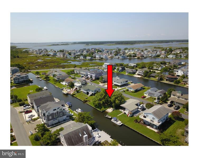Over-sized Canal Front lot with your own private boat ramp!  Located in quiet South Bethany with access to Jefferson Creek, Little Bay, & other waterways.  Great location - an easy walk to the beach, and a bike ride away to Downtown Bethany and the boardwalk.  Rehab the existing home or take advantage of this fantastic opportunity to build the home of your dreams.