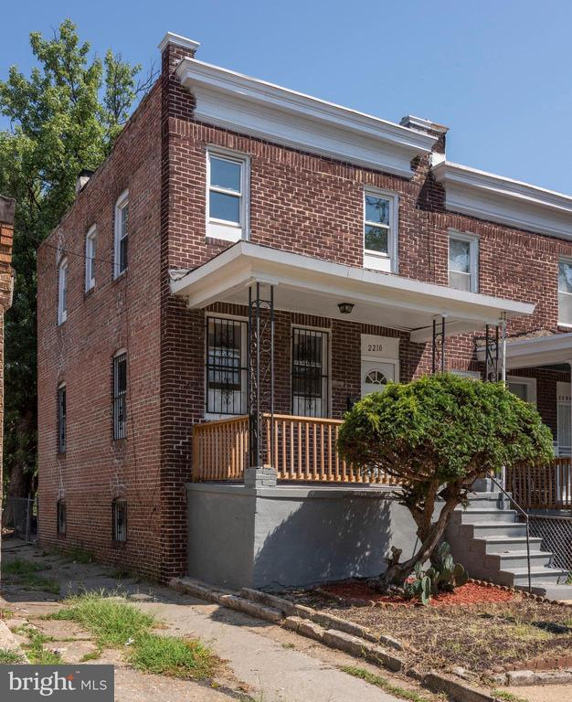 NEW PRICE ON THIS Restored Traditional Baltimore Brick Row Home. The home ready for you to move in. This end unit features 2 bedrooms and 1 bath, with a bonus room for you to use as you wish. Could be a work from home office, a study or den, playroom, nursery, or even a spare bedroom. Soft carpet on the bedroom level for your comfort. Nice size master and second bedroom as well. Enter into the home from your covered front porch. Main level features new hardwood floors throughout living room and dining, with plenty of natural light. Kitchen with granite counter tops, and updated appliances. Laundry in basement. Connecting stairway to fenced in back yard.  Washer and dryer to be included. Windows, and flooring new in 2017, roof also resealed.  HVAC system, central air to be installed prior to settlement. Could be your new home.  Why rent when you can Own for less than rent costs. Bring Back Baltimore.