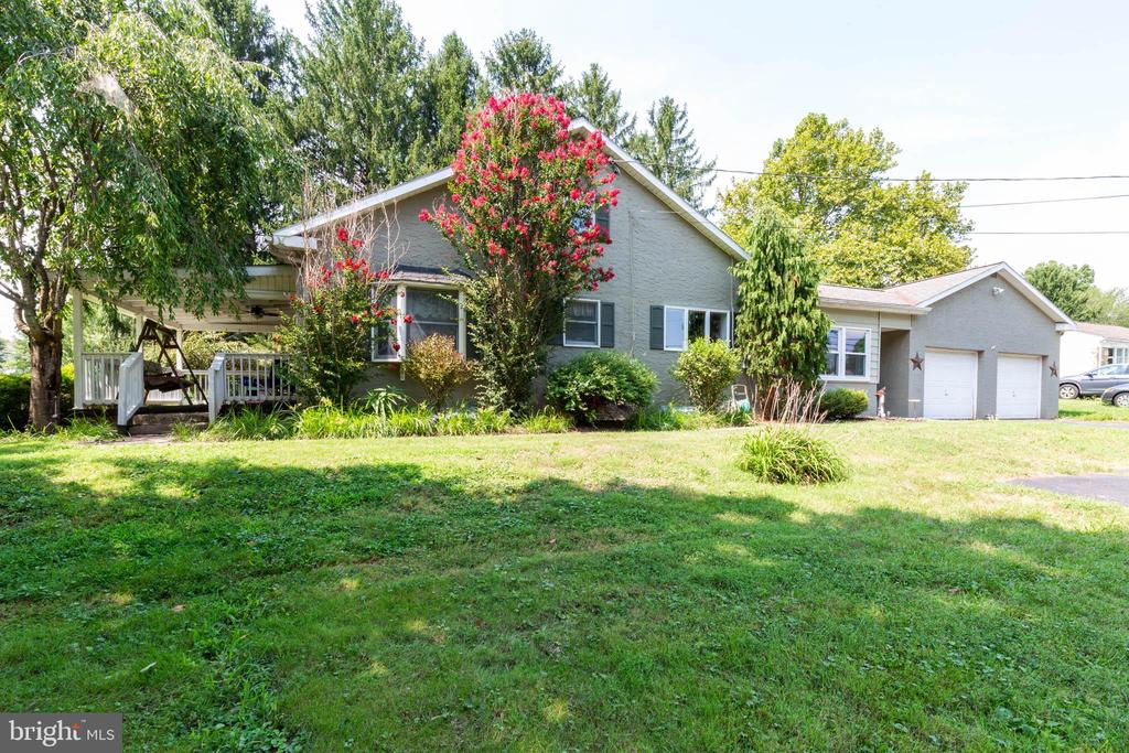 Welcome Home! This 5 bedroom 2  bath Customized Cape Cod in East Vincent Township is situated on a .78 acre corner lot with wonderful views and move in ready!Upon arriving you will notice the large driveway with ample parking plus two car garage.You can enter thru the breezeway entrance into the sunroom or follow the path to the front porch with magnificent view of the yard and surrounding countryside. Also notice the lush landscaping and manicured lawn.Once inside you are greeted by shiny hardwood flooring that flows thru most of the main level. Living room flows into a dining room with plenty of natural lighting and upgraded light fixtures.The kitchen is the hub of this home and features include newly added granite counters plus new appliances and ceiling fan with light.The sunroom is a true delight and that leads to a patio breezeway to the rear yard plus large 2 car garage with tons of storage ..The first floor features include a main bedroom  with ceiling fan  plus 2 additional bedrooms all with plenty of closet space.There is a full bath with upgraded marble vanity plus stain glass window and upgraded lighting plus tub. The upper level features two large additional bedrooms with full bath.Rooms can be used as workout/gym, home office, craft room...the list goes on. The lower level is unfinished and features the laundry area. The hot water heater was replaced in 2018 plus there are replacement windows. The location of this home in Owen J Roberts School District is minutes to premium shopping and restaurants, major highways and downtown Phoenixville. Great home in a great locationn