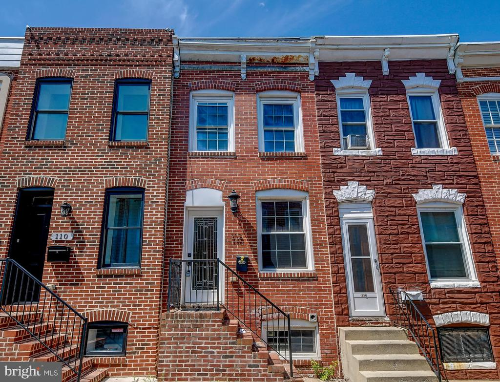 Well maintained rowhome 1 block from Patterson Park! Beautiful exposed brick inside, granite counters, hardwood floors and recessed lighting. Freshly painted throughout, new carpet in the upper & lower Levels. New Hot Water Heater. There is a rear deck for your outside enjoyment and a parking pad in rear.  Live & enjoy the City Life. Move in ready! AS-IS Condition.