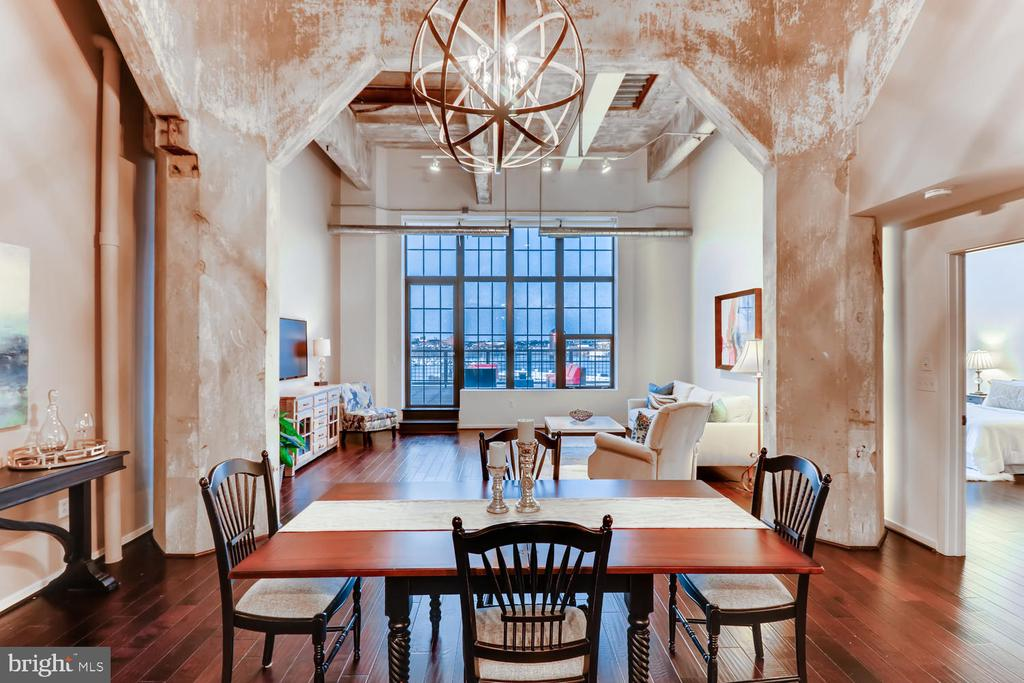 Exceptional 2 bedroom 2.5 bath Silo Point Tower Residence boasts over 1,896 square feet of interior living space and over 800 square feet of outdoor terrace space. This architecturally impressive condominium showcases an open floor plan with soaring 16-foot exposed concrete ceilings, floor-to-ceiling windows, hand scraped hardwood floors, Chef's kitchen with Viking appliances, Lutron motorized blinds and a spacious Master Suite with generous walk-in closet. 2 dedicated parking spaces and separate storage room are included with this offering. Live in the highly coveted, full-service condominium, Silo Point: 24-hour concierge, Fitness Center, and 19th Floor Sky Lounge.