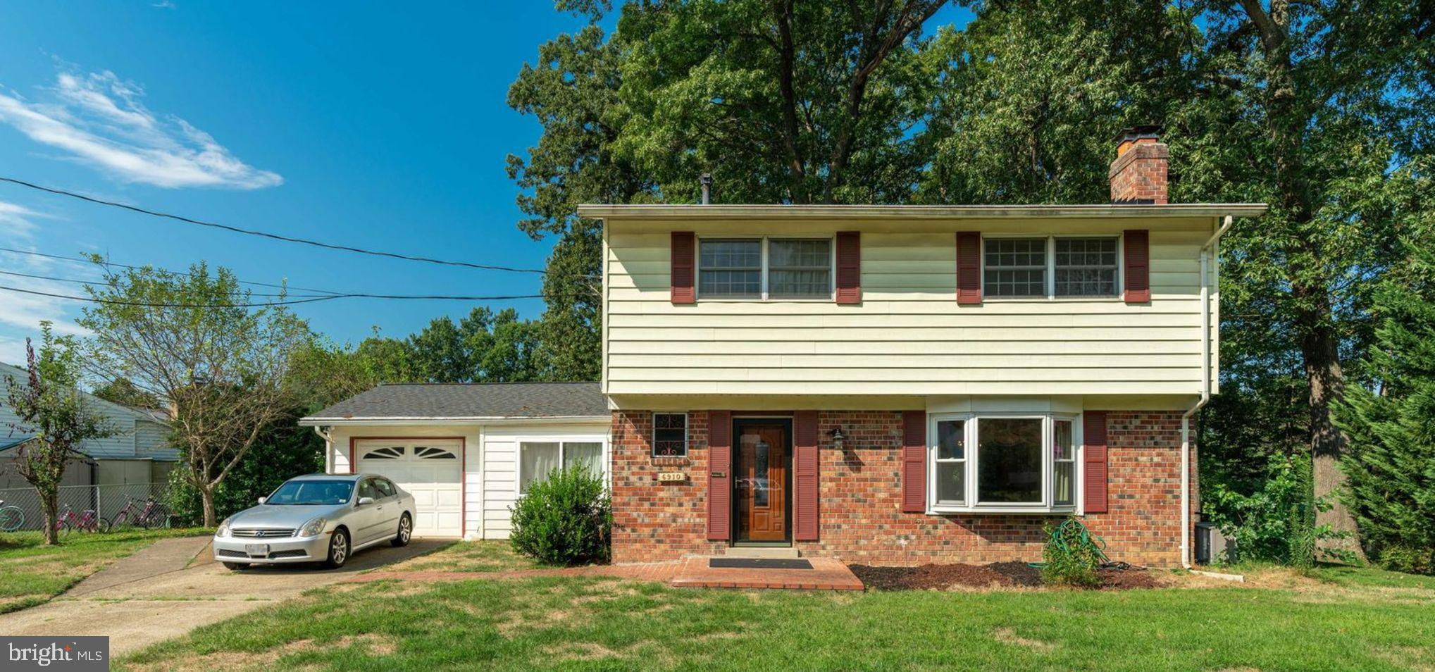 Motivated Seller! MASSIVE PRICE DROP! Beautiful 4 Bedroom, 2.5 Bath is ready for you to put your personal stamp on it!  Sunny and bright main level, with gorgeous upgraded kitchen.  Living Room has an inviting fireplace.  Sunroom/Family Room is the perfect place to unwind. Hardwoods under carpet!  You'll fall in love the large, flat back yard with patio.  Sold AS IS and ready for you to add your special touches to the unfinished basement!! Now is a great time to make your dreams of owning a home come true!
