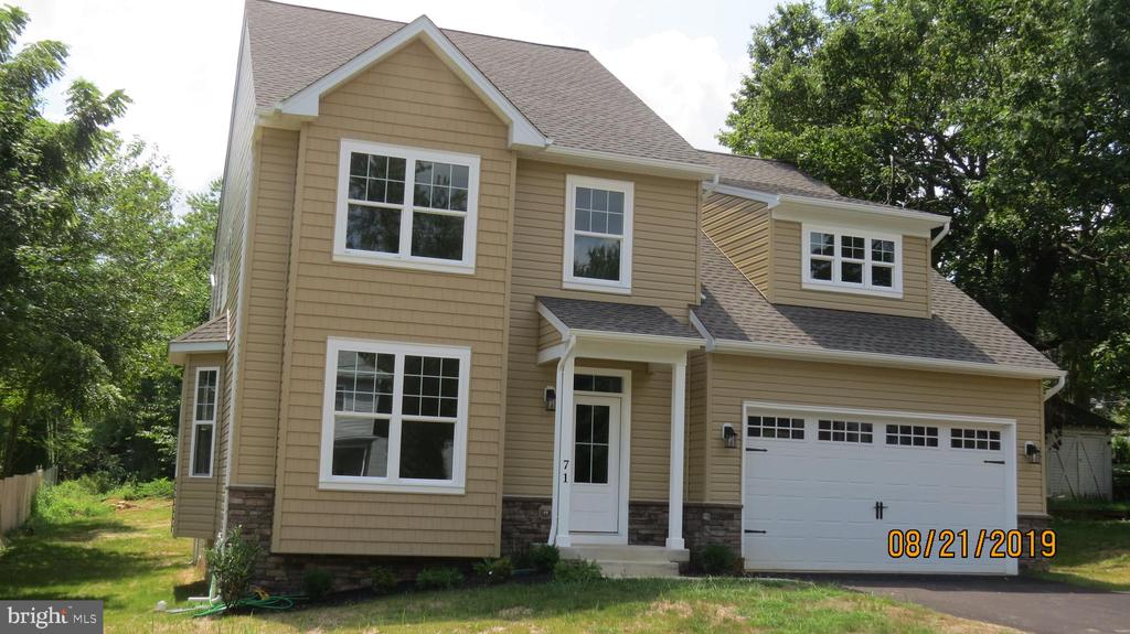REDUCED ! BUILDER'S MODEL HOME.                 2700 sq. ft. (PLUS 600 sq. ft. FINISHED BSMT.)    colonial with loads of amenities. FIRST FLOOR    FAMILY ROOM W/ REMOTE CONTROL GAS FIREPLACE. Owner's SUPER BATH w/ 2- person           corner tub &  separate shower. MORNING ROOM OFF KITCHEN. HUGE FINISHED MAN-CAVE w/ 9' CEILINGS. OWNER'S BEDROOM w/ TRAY CEIL WALK-IN-CLOSET AND SITTING AREA. Deluxe   kitchen w/ island, recessed lighting, hardwood     floors and stainless appliances. Transitional floor plan with lots of open concept space, but still       having real LR & DR.                                                     Property taxes are estimated (new home)             NO HOA OR DEFERRED WATER & SEWER FEES. Tax assessment amount is listed as 0 because no  tax assessment has taken place yet (new home).  Great upper level loft can be used as another TV room or as teen gaming/computer area.                  2-zone HVAC.
