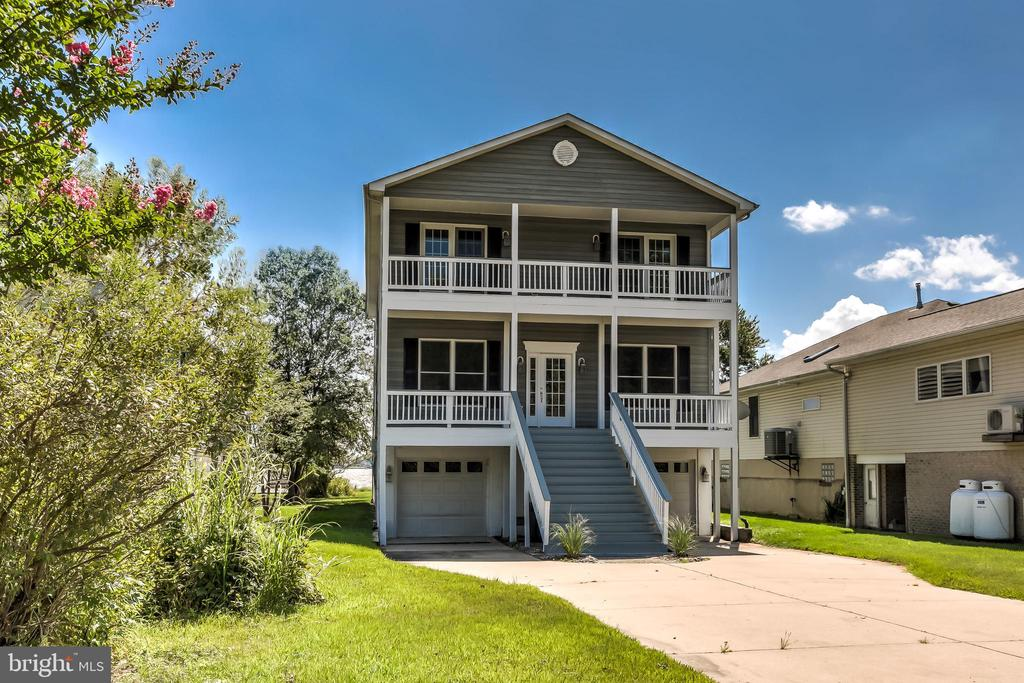 4BR, 3BA HOME ON THE CHESAPEAKE W/BREATHTAKING VIEWS AND 3 STOP ELEVATOR! GOURMET KITCHEN W/GRANITE, SS APPLIANCE FLOWS TO LR W/ GAS FP & ACCESS TO WATERFRONT DECK. MBR W/FP, IMPRESSIVE MASTER BATH, 2ND FLOOR LAUNDRY.CHERRY FLOORS THROUGHOUT HOUSE, WALK-OUT LL. 110 FT PIER W/2 BOAT DOCKS, RIP-RAP BULKHEAD