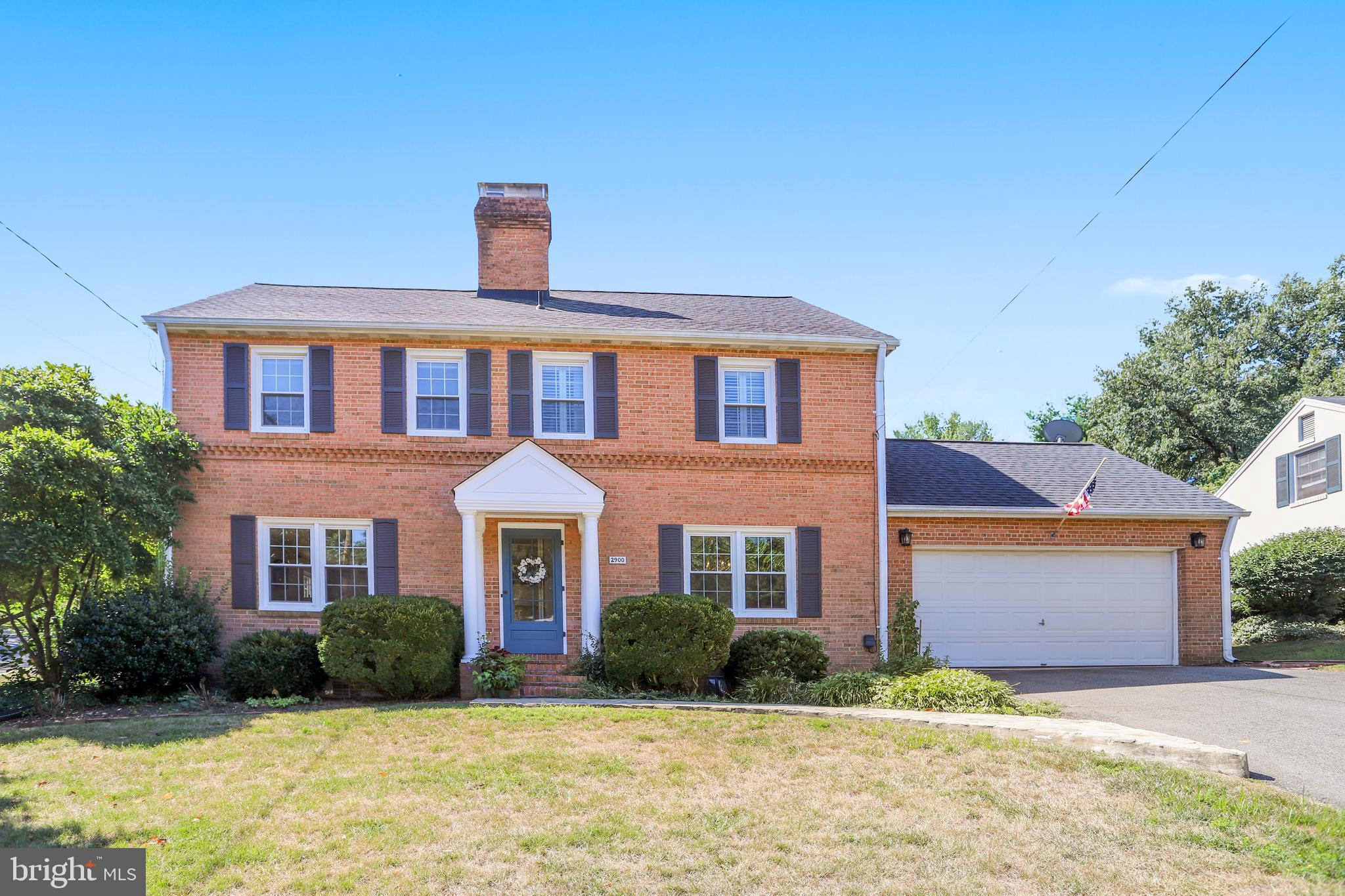 A beautiful Magnolia tree enhances this 3,000 square foot brick Colonial in the highly sought after, close-in Clover neighborhood. Just minutes from all major roadways, the King Street Metro, DC, Old Town, the Pentagon and Reagan National Airport.  Boasting four bedrooms and two updated baths on the upper level and a convenient, remodeled half bath on the main level. Beautiful hardwood floors. Brand new carpet in the lower level family room, den/office and in one of the upper level bedrooms. Two-car attached garage! Walking distance to Douglas MacArthur Elementary school. This one is not to be missed....So much space at such a great price! Very quiet section of the community...and very lightly traveled street!