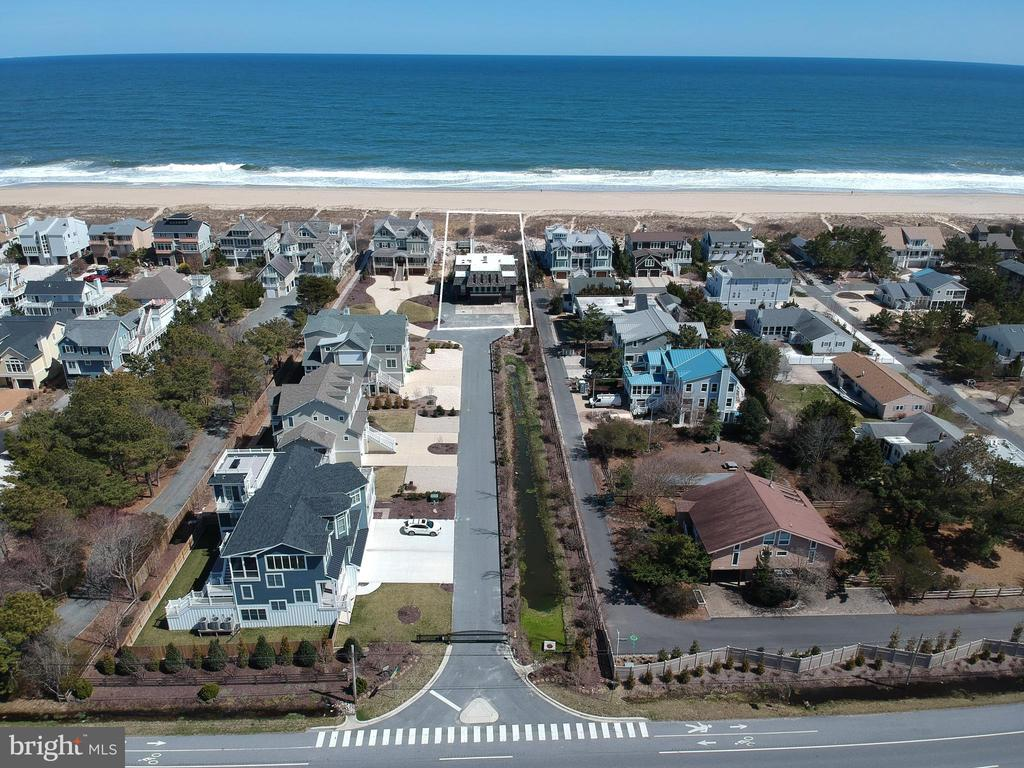 With 75 feet of pristine Oceanfront, this parcel of land is a rare opportunity within the highly desirable community of Dukes Dune. This over-sized lot is situated among 4 newly constructed luxury homes, this is one of the most sought-after locations on the Delaware Coast.  This property offers the unique ability to construct a sizable home with the option for a private pool while capturing unobstructed ocean views as well as evening sunset vistas over the Salt Pond.  Enjoy direct beach access from your personal boardwalk to a quiet, secluded beach while maintaining the convenience of being just a short walk into town.
