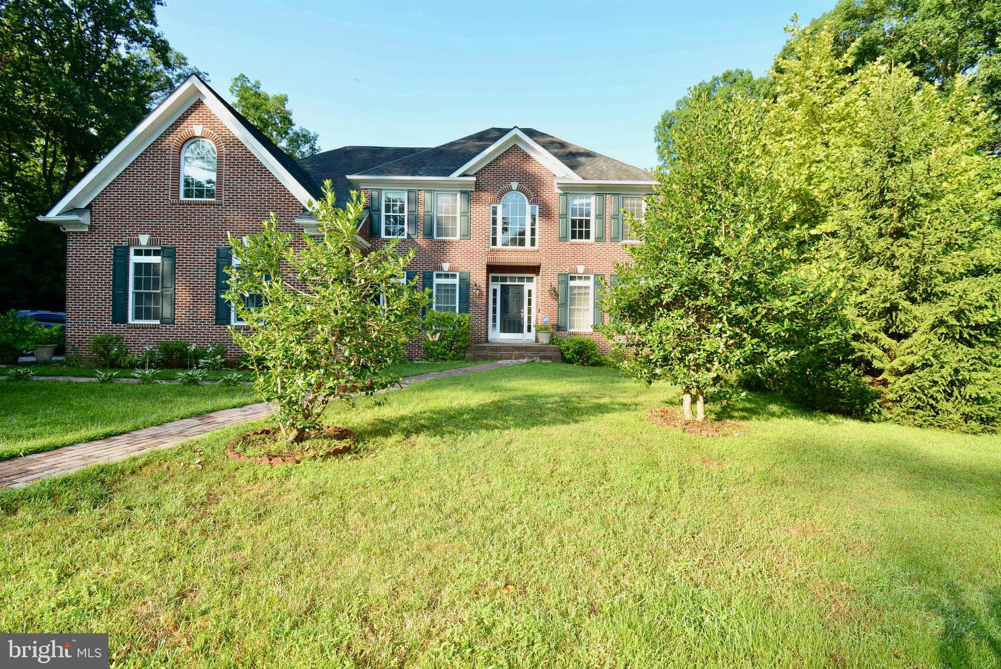 OPEN HOUSE Sun 8/25 1-4pm.  New Price!  Motivated seller has found the home of their choice and is encouraging ALL OFFERS!  This is must-see, beautiful colonial home offers nearly 6,000 sq. ft. of living space.  Built in 2007 and no HOA.  A three-car garage plus driveway space provide ample parking.  The main floor features hardwood or brand new carpets and a two-story, open family room.  The kitchen boasts stainless steel appliances as well as brand new granite counter-tops and walks out onto a large deck with two staircases down to the backyard.  The upper level features four bedrooms accessed by TWO staircases.  The master bedroom features a tray ceiling and a GIGANTIC master bath and walk-in closets.  A finished, walk-out basement on the lower level completes this home with its own bedroom and large full bath.  This home is a must see! Blocks from Laurel Hill Golf Club and South County Middle School and High School.  The Workhouse Arts Center, historic Mason Neck, Fountainhead and Sandy Run Regional Parks just minutes away.  Grocery shopping and restaurants are five minutes away.  Commuting is made easy with proximity to 95, the VRE, Rt. 1, and the Fairfax County Parkway!  No HOA!