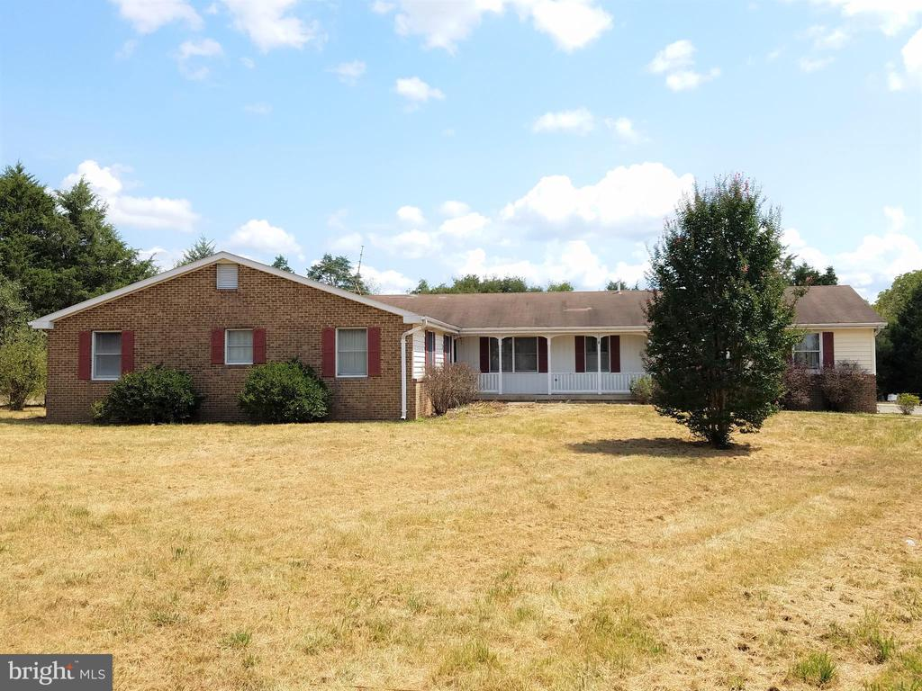 Investors and HGTV lovers!  This single family home on 3 acres in Nokesville with no HOA offers a great opportunity to work your magic!  Rambler-style gives you convenient main level living with 4 bedrooms, 2.5 bathrooms, and a 2 car side-load garage.  Enjoy the pastoral views of the grassy fields and trees behind the home from a screened porch!  Plenty of space in the basement that is currently configured to include a game room, exercise area, workshop, and utility area.  Recent updates appear to include newer hot water heater and newer exterior air conditioning compressor.  Nokesville Community Park, located only one block away off Aden Road, contains baseball fields, soccer fields, volleyball courts, a playground, a horseshoe pit, and an equestrian area.  Bridle and walking trails, a picnic pavilion, and a concession stand make this a wonderful recreation destination!  Nokesville has a relaxed, small-town country feel with privacy, acreage, horse barns, and local schools yet only minutes from all the retail shopping, restaurants, and entertainment amenities of Gainesville, Bristow, and Manassas.  Nokesville is easy to reach by Routes 28 and 234 bypass, or the VRE train station in Manassas.  Priced lower than recent comps and below 2019 tax assessment ($420k) to reflect current condition.  Home is in fair shape overall, but everything needs a little work to make this your own private castle!