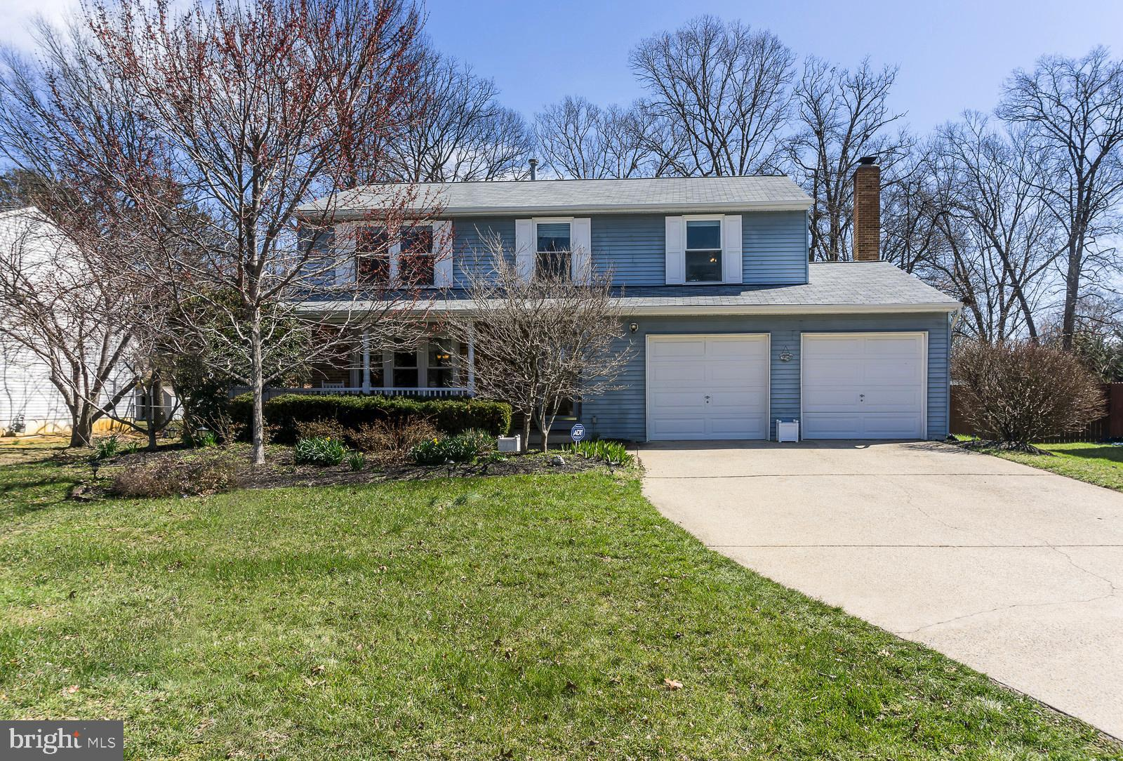 A 4 bedroom/ 3.5 bath home with 2 car garages in Springfield, VA under$600,000! This home is move in ready with fresh paint throughout, over 2768square feet of living space. Hardwood floors on in the living room, dining room and family room. The sun filled eat in kitchen has tile floors and overlooks the cozy family room with wood-burning fireplace. Family room opens to enclosed sun room porch that opens onto the flat backyard, the lot is over a quarter acre and perfect for entertaining, games or pets! The back yard also features a man cave with optional electricity perfect for hanging out! The master bedroom features a walk-in closet, updated master bath. 3 additional bedrooms are upstairs along with a hall bath. The basement features 3 separate areas perfect for work out room, playroom, game room, TV room and so much more! Plus tons of storage in laundry room- don~t miss this home!