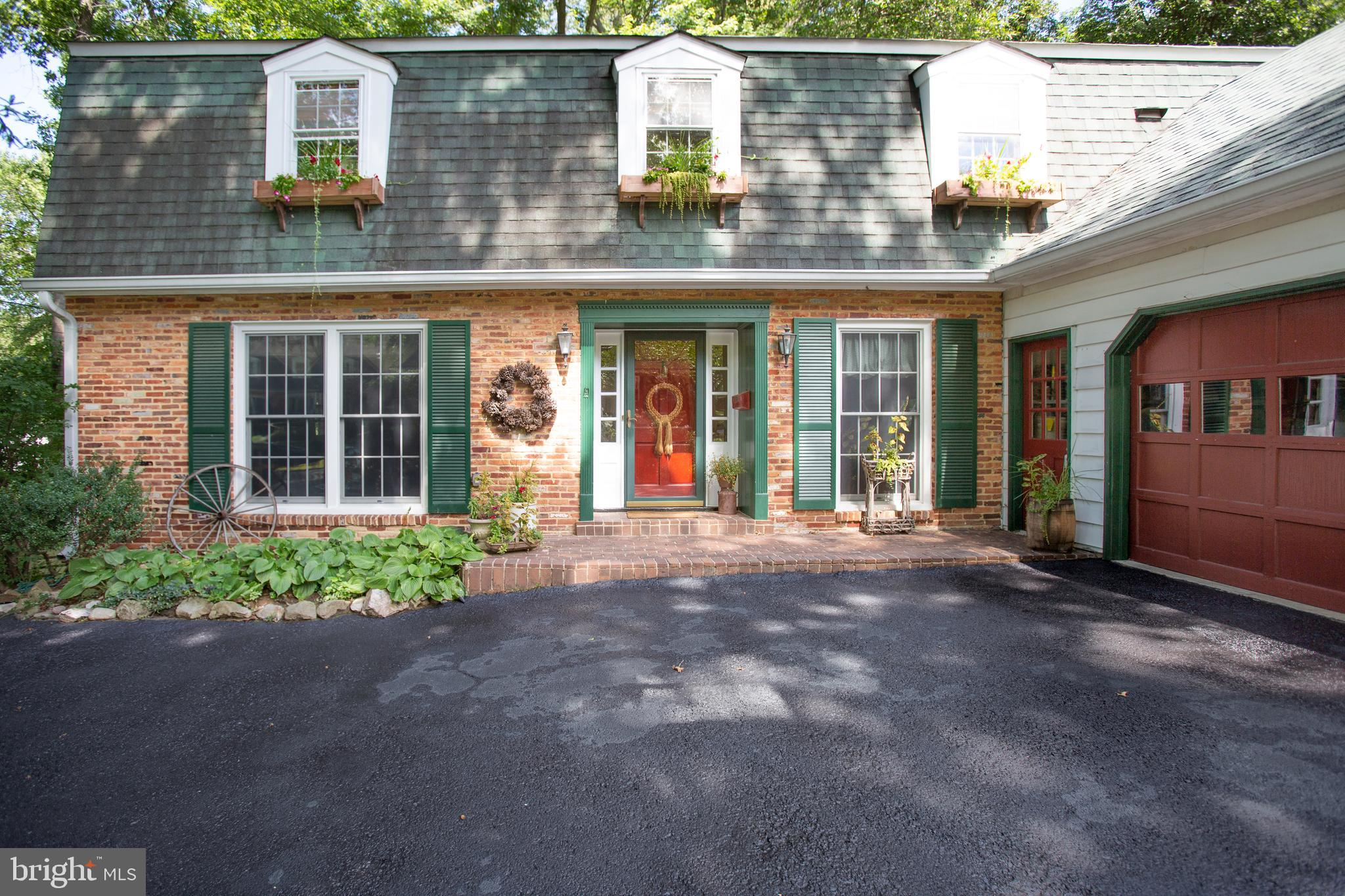 Location, location, location! In sought after Camelot on ~ + acre wooded lot. Minutes from 495, INOVA Hospital Campus and Mosaic District. Walk to community pool and Camelot Elementary School. This home was designed with the flexibility to have a first-floor master, but the 5 upper level bedrooms and 4 ~ bathrooms provide ample space for large families. 2800 + sq ft above grade living space plus finished walk-out basement with full bath. Screened-in porch, flagstone patio, updated appliances, counter tops and hardwood floors on main and upper levels!