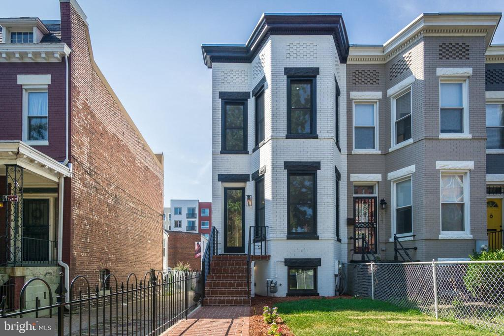 $7,000 BUYER'S AGENT BONUS TO HAVE A CONTRACT RATIFIED AND SETTLED BY THE END OF THE YEAR!!!!!Located close-in TO H ST NE. This expansive corner unit,  5 bedrooms, 3.5-bathroom Federal row home set over three finished levels is an opportunity not to miss. Details include, Energy Efficient Windows, recessed lighting, walls of windows, exposed brick, 13~ wrap around quartz kitchen island, and stunning hardwood floors throughout. The chef's kitchen is outfitted with stainless steel top-of-the-line kitchen aid appliances! Upstairs you will find three spacious bedrooms, each flooded with natural light, and equipped with large closets, Two bathrooms and a full Laundry. Step downstairs to the incredible basement. Configured as a stunning apartment, additional storage spaces, full kitchen, laundry hookup, two bedrooms and one bath. The possibilities are endless here. Finally, two parking spaces on the back truly completes this home. Live in the heart of H ST NE, with the new Whole Foods, Trader Joes, fine dining from Capitol Hill to H ST to Union Market, NoMa Redline Metro, and Union Station.