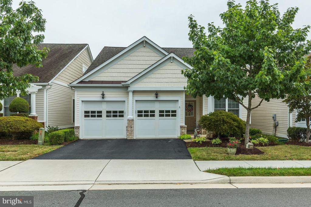 Welcome home to the much desired 55+ community of Spring Hill in Lorton!  New Roof (2016), New Furnace/AC/Water Heater (2018), New Washer/Dryer (2018), New Sunsetter Retractable Awning (2018). This popular Somerset model, 3bd/3bath with loft and bonus office is a main-level living dream.  White Orchid features an open floor plan with ample natural light. Kitchen has granite counter tops, double ovens, and gas range. The kitchen opens to a bright family  room with vaulted ceilings. The master bedroom has tray ceilings and large en-suite bathroom.  Upstairs loft overlooks the family room, 3rd bedroom has private full bath. Relax and stay cool on your deck with retractable awning.  Enjoy indoor swimming, exercise classes, and gathering with friends in the clubhouse.  VRE is less than 3 miles. Buses to VRE and Springfield Metro Station. INOVA Healthplex is less than 2 miles.