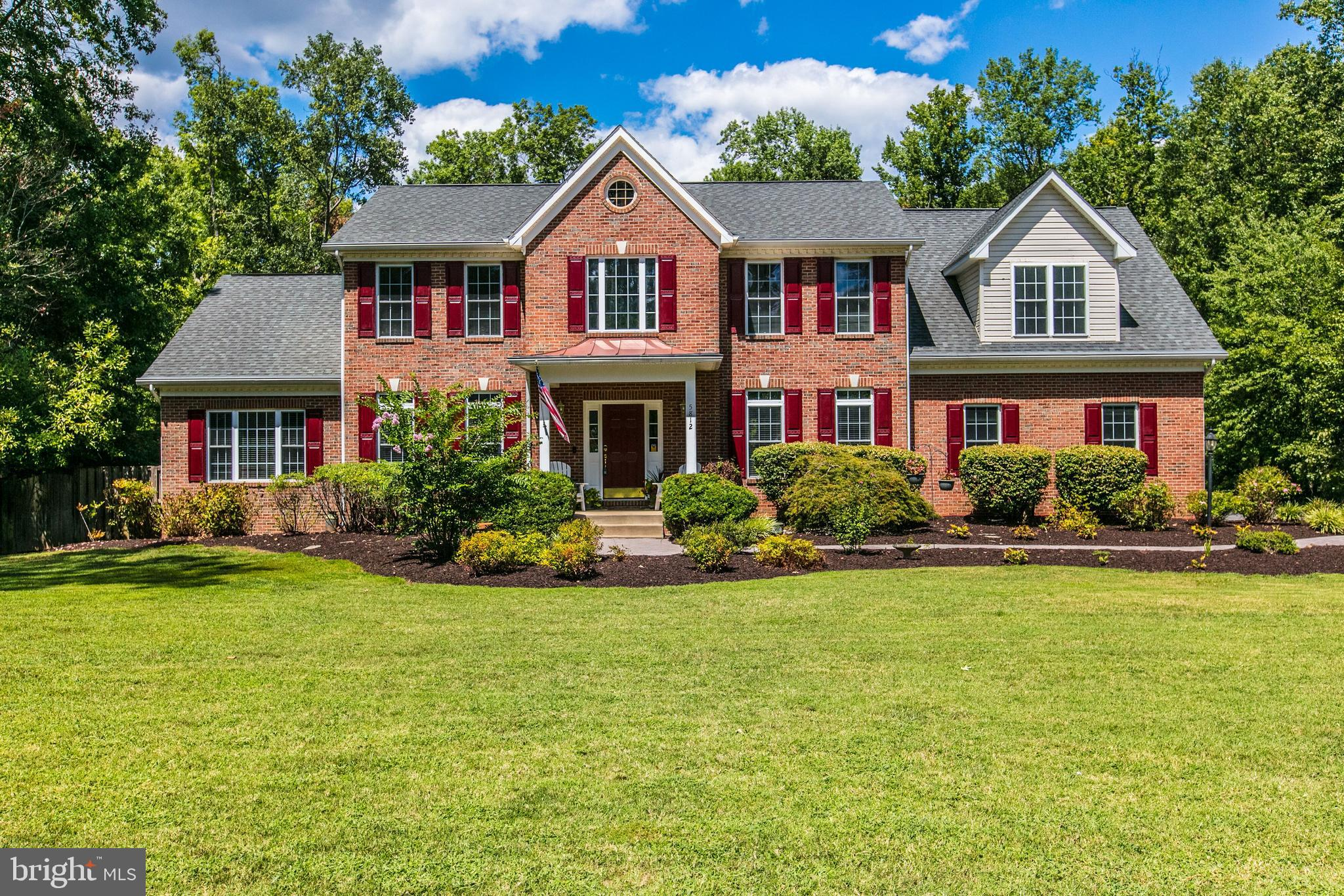 OPEN HOUSE SUN 9/22 1-4PM.   SO many great features in this expanded colonial for you (and your guests) to enjoy!  Nearly 6000 finished SF including a recently-completed lower level with 5th bedroom, full bathroom, custom bar, and space for entertaining.  Open floor plan has welcoming 2-story foyer, separate living and dining rooms, a HUGE family room w/gas fireplace, large gourmet kitchen w/island, and main level private office. Upstairs are 2 master suites with vaulted ceilings, two generous-size bedrooms, and laundry room. OUTSTANDING 1.25 acre lot has well-landscaped and fenced yard with multi-level decks, pool, hot tub, screened-in garden, tree house and more.  LOTS of open space.  3-car side-load garage, mud room, 2 storage sheds and lots of space for your water toys!  Private setting in desirable community w/access to private beach, boat launch, playground, & tennis/BB courts.  So close to all that historic Mason Neck has to offer - Potomac River access, parks, wildlife, golf, and much more.  This one has so much to offer...at a great value!