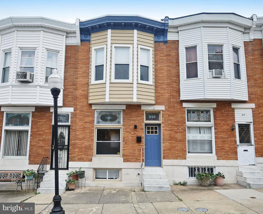 Renovated, refreshed, and super spacious row home situated directly across from Patterson Park in Highlandtown. Enjoy modern updates with the restored Baltimore charm of stained glass windows and exposed brick walls throughout the home. Enter into living room with gleaming hardwood floors, bright with natural light from the large front-facing picture window that includes exquisite stained-glass. Exposed brick wall, crown molding, recessed lighting and a ceiling fan all complement this neutral move-in ready space.  Living area extends to dining area off of kitchen with ceiling fan and crown molding. Fully renovated kitchen features stainless steel appliances, tons of bright white cabinets, and counters topped with granite accented by a tile backsplash on one side and exposed brick on the other. Kitchen features island with pendant lighting and breakfast nook, along with a walk out to the rear deck with stairs to yard area backing to alley. Upper level boasts hardwood floors throughout and exposed brick wall in hallway. Large master bedroom suite with hardwood, ceiling fan, crown molding, walk in closet and stunning master bath. Full master bath features a dual vanity and double shower heads in spacious tiled stall shower. Second bedroom on upper level is of generous size with ceiling fan, exposed brick accent, crown molding, and walk out to private balcony facing the rear of the home. Fully finished basement provides tons of flexible family space and boasts a newly finished full bath with tiled shower, allowing this space to be used as a third bedroom. Recessed light, storage space, new carpet, and laundry also on this level. Enjoy a short walk across the street to Patterson Park and close proximity to restaurants and local attractions in the heart of Baltimore! This one surely will not last.  A MUST SEE TODAY!