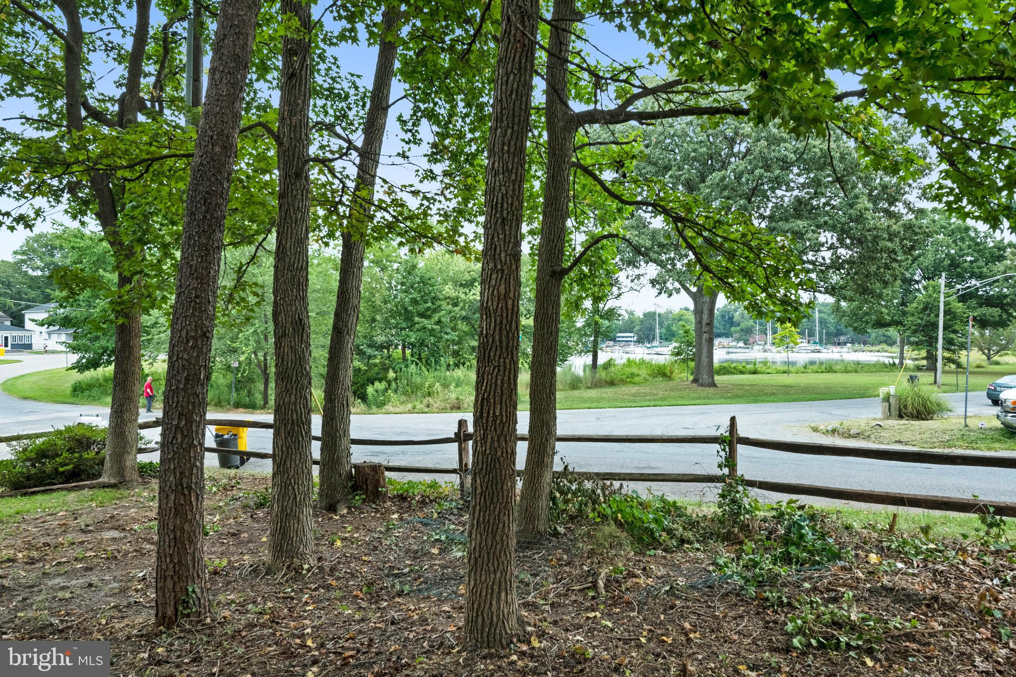 Wonderful water views of Almshouse Creek!  40x100 lot. Great opportunity to build in a water privileged community with amenities that include multiple marinas, playgrounds, beaches and boat ramp.  Launch your kayaks and paddle boards across the street!  Head out by boat and be in the South River or Chesapeake Bay in no time.  Close to schools, shopping and restaurants.  Quick 10 minute commute to Annapolis and close to rt 50 and 97 for commuting to DC and Baltimore areas.